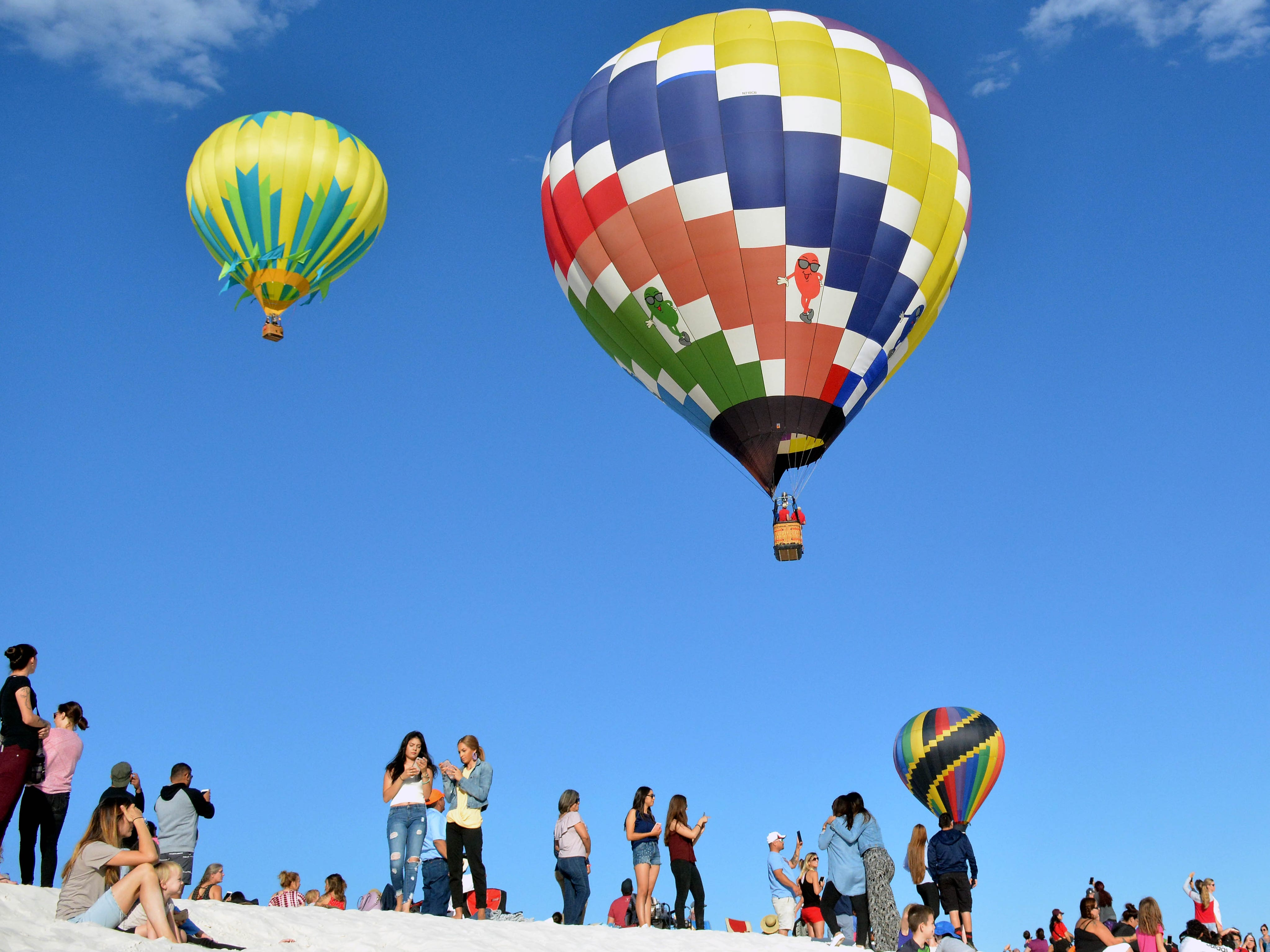 Balloons take flight over the dunes Saturday, Sept. 15, 2018 at the White Sands Balloon Invitational.
