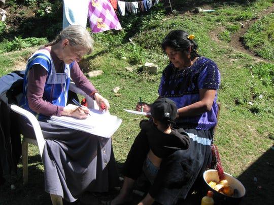 NMSU professor emeritus Christine Eber works on Flor de Margarita Pérez Pérez' life story with her.