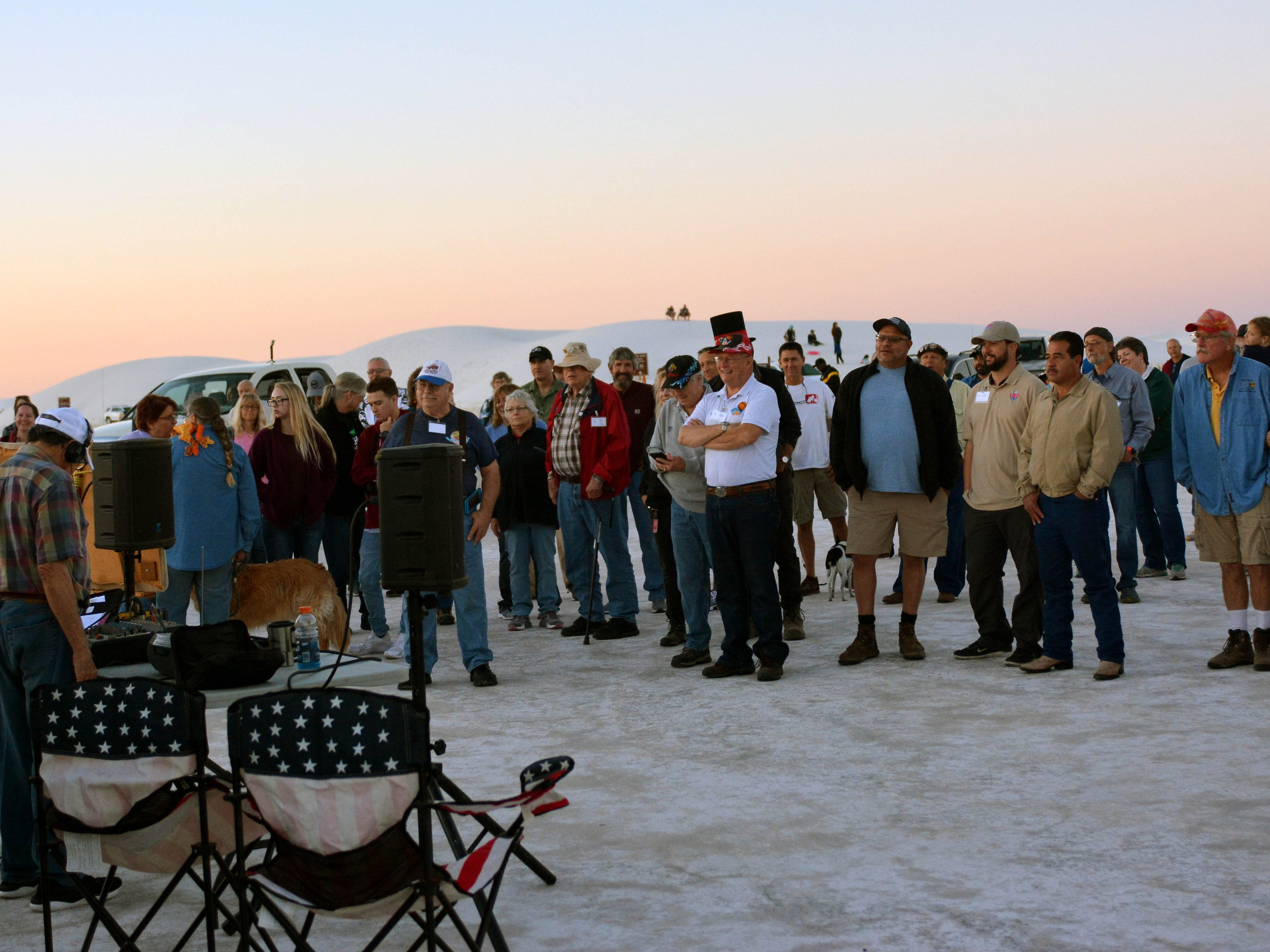 Pilots gather to hear the latest weather conditions before takeoff Saturday, Sept. 15, 2018 at the White Sands Balloon Invitational.