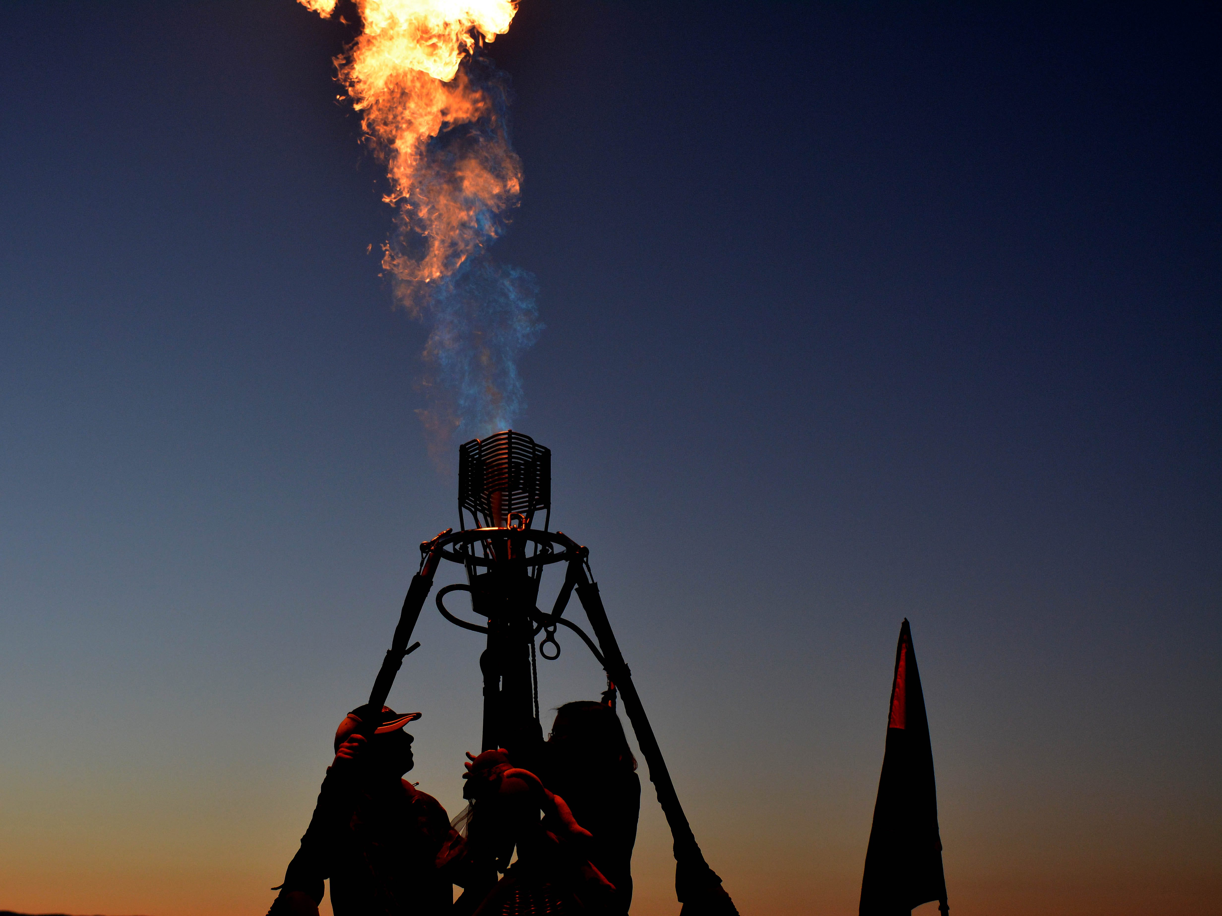 A balloon pilot tests the propane burner before the sun rises Saturday, Sept. 15, 2018 at the White Sands Balloon Invitational.