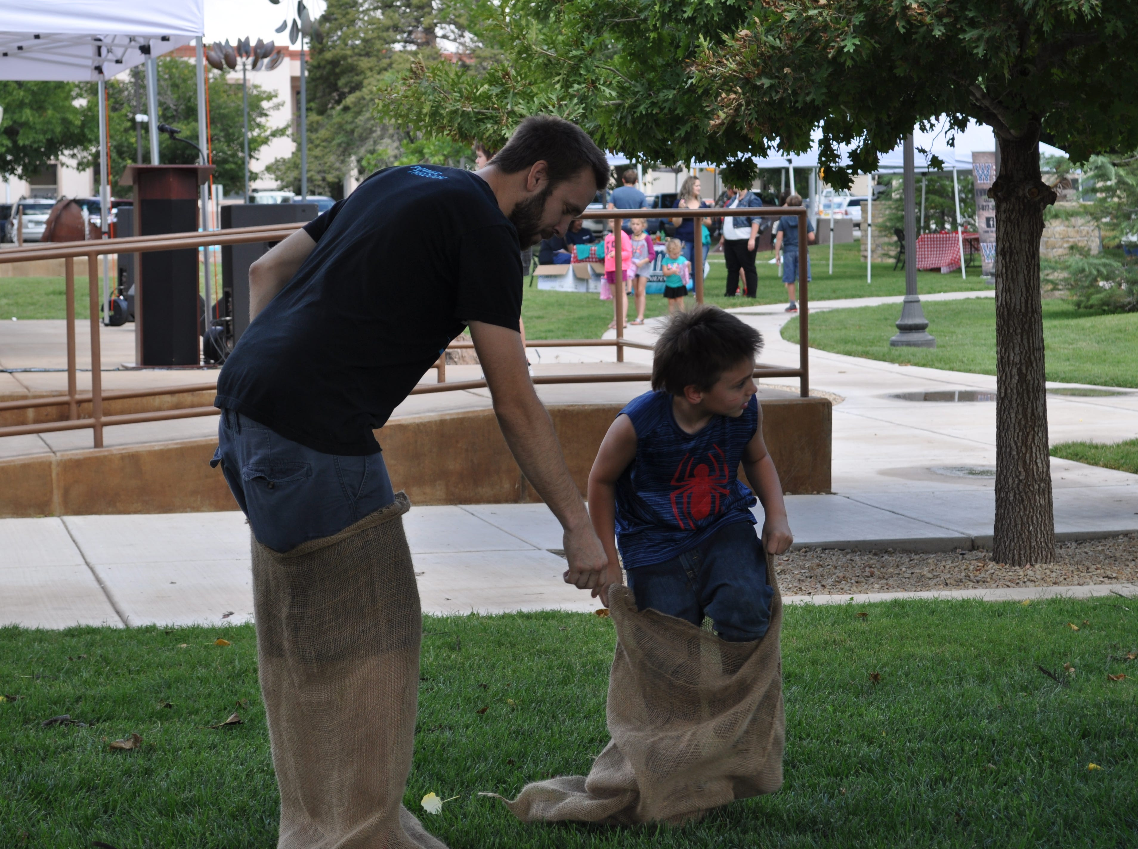 Sack races were part of the fun for children and adults at the Halagueno Arts Park where the annual Heritage Fest was held in Carlsbad, New Mexico.