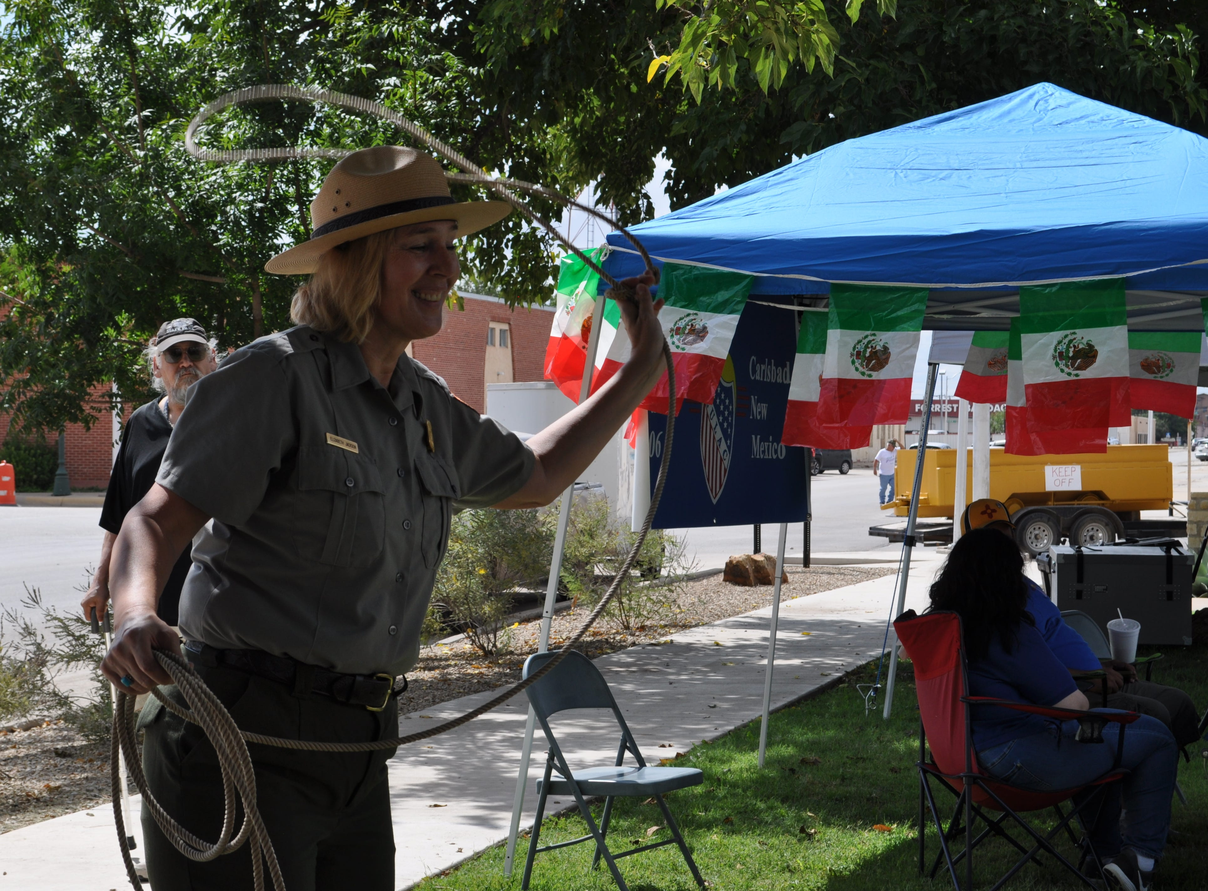 Elizabeth Jackson a National Parks Ranger with Guadalupe Mountains National Park tries her hand at calf roping Sep. 15 during Heritage Fest at the Halagueno Arts Park.