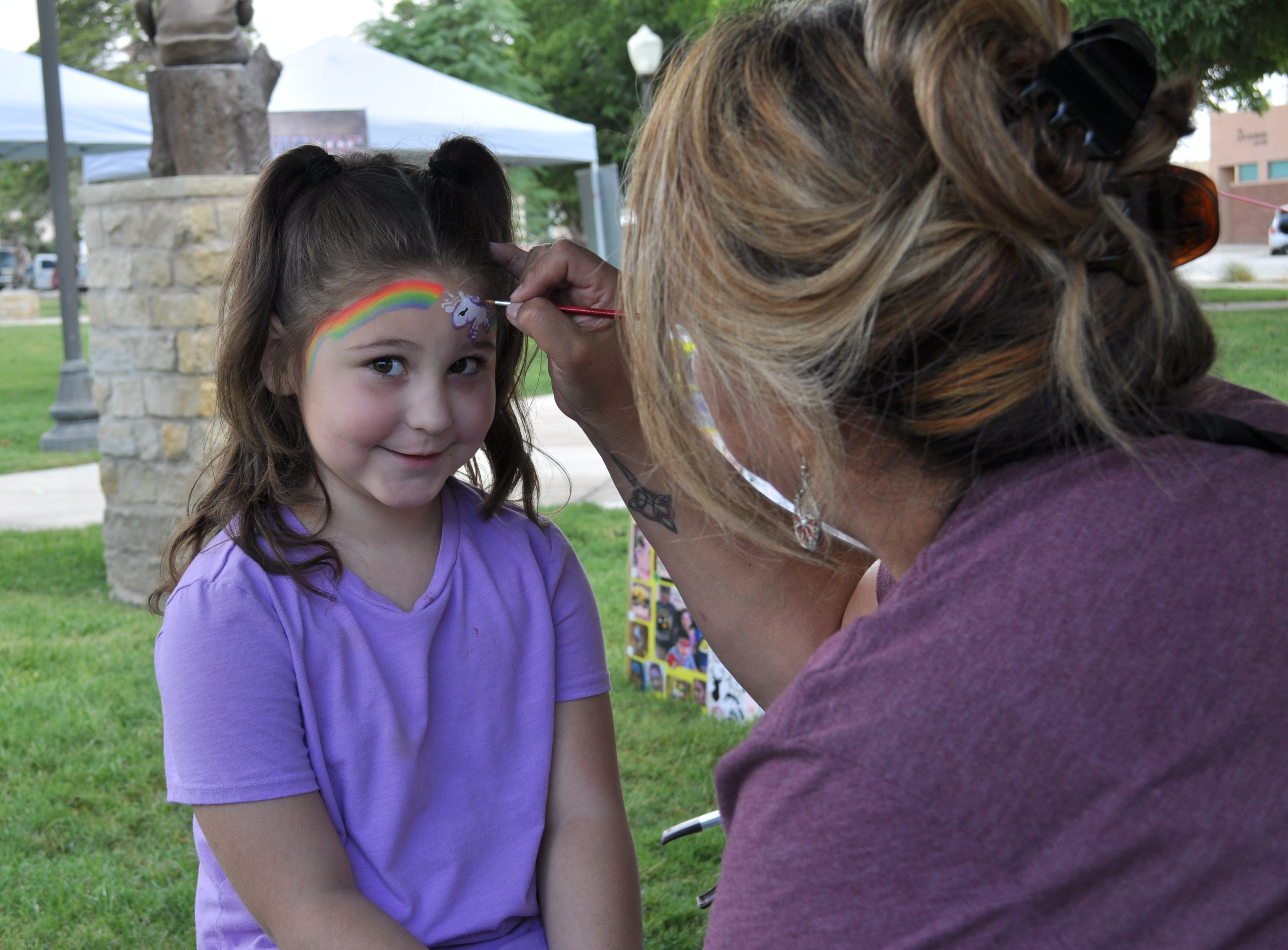 A young girls gets her face painted at the annual Heritage Fest in Carlsbad Sep. 15.