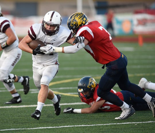 South Lyon defeats Birmingham Seaholm 31-28 on a field goal with 5 seconds remaining in the game to go 4-0 on the season.