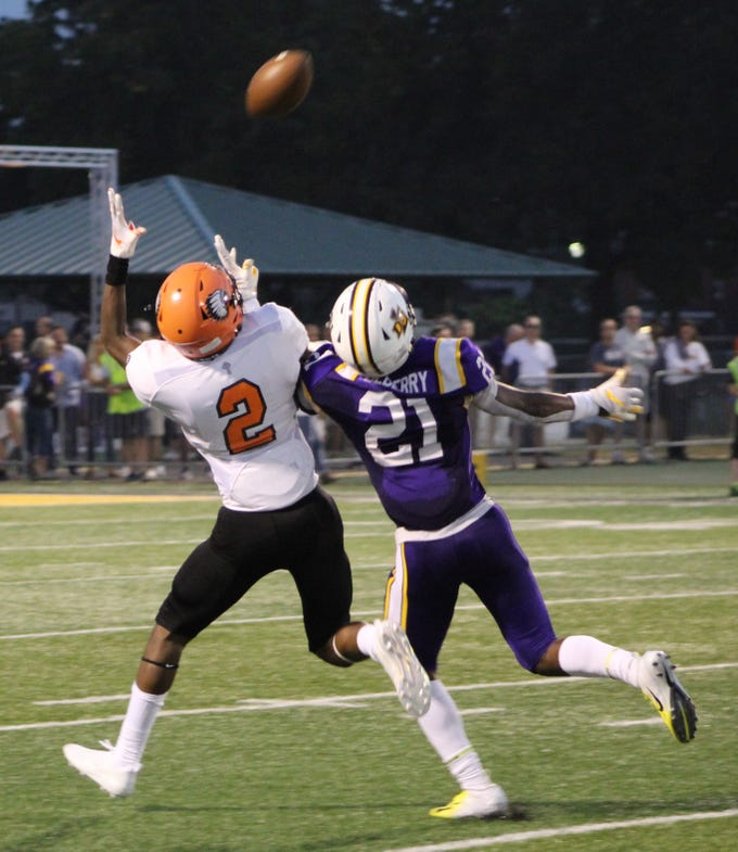 Brother Rice corner back Jonathan Tillman (2) nearly intercepts this second-quarter pass intended for De La Salle receiver Joshua DeBerry (21).