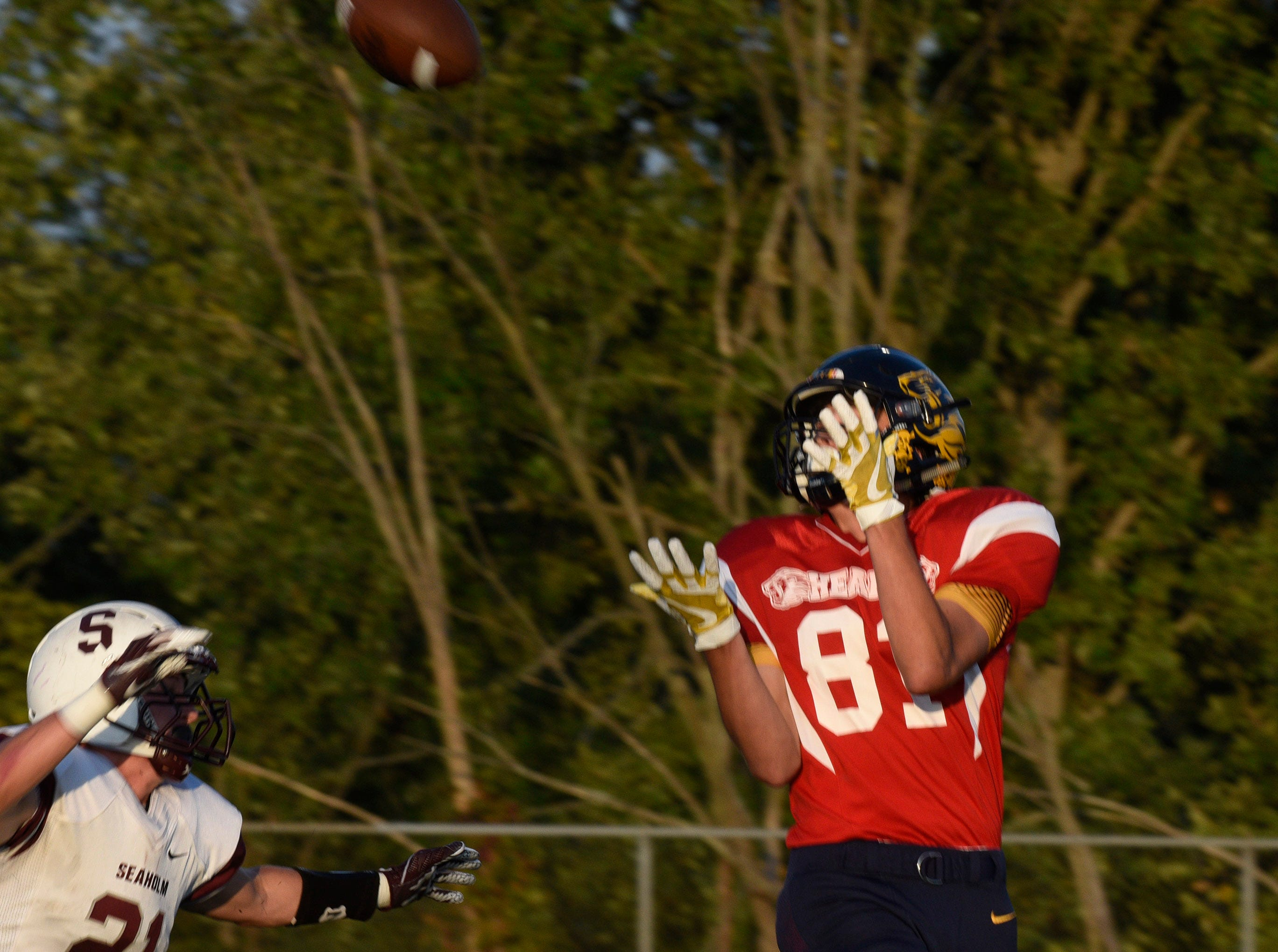 South Lyon's Lach Brenden hauls in a pass on the first play from scrimmage scoring a TD.