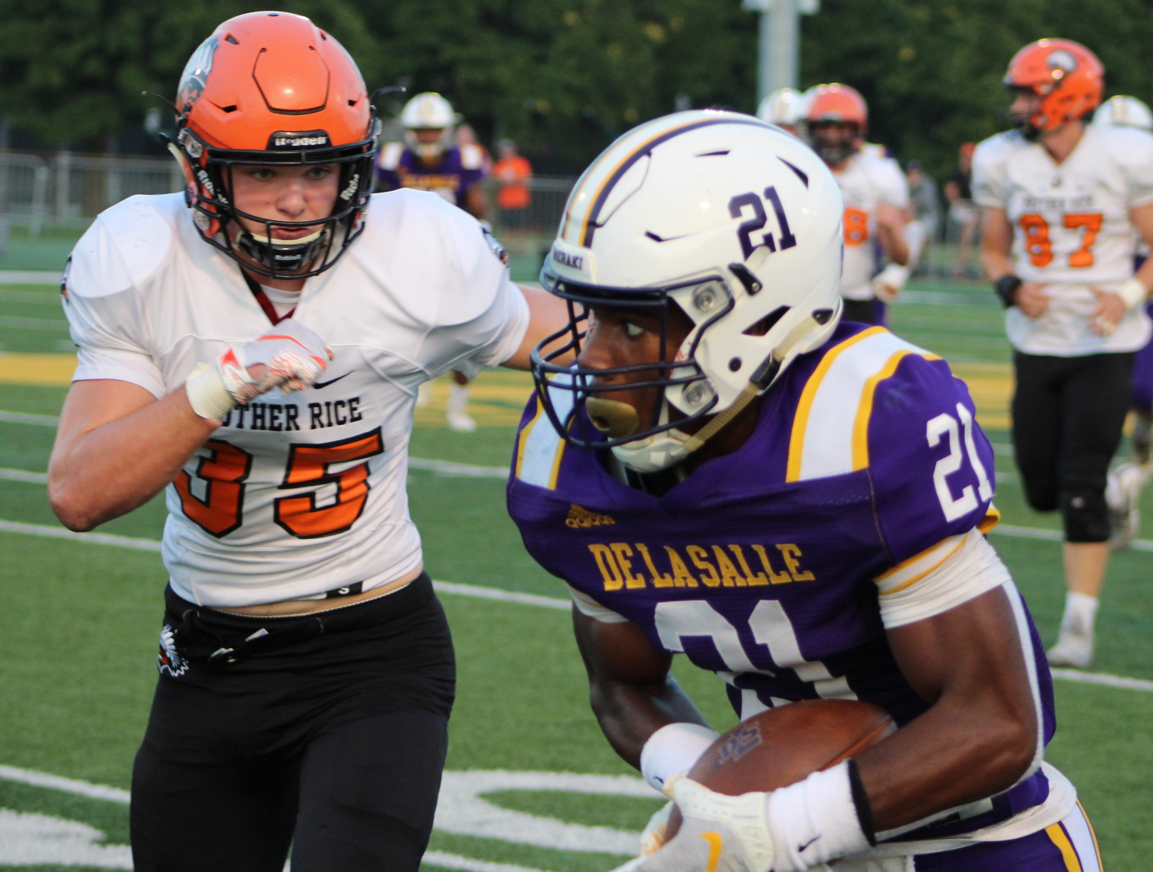 De La Salle receiver Joshua DeBerry (21) is chased down by Brother Rice defender John Hoen (35).