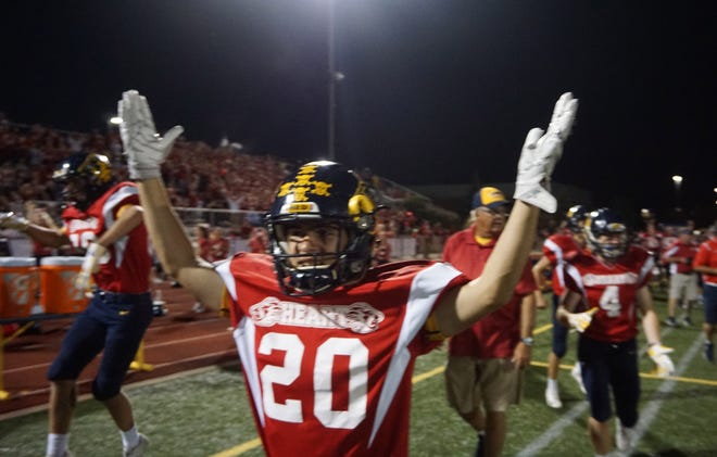 South yon's Jack Misfud celebrates a second half TD during the Lions 31-28 victory over Birmingham Seaholm.