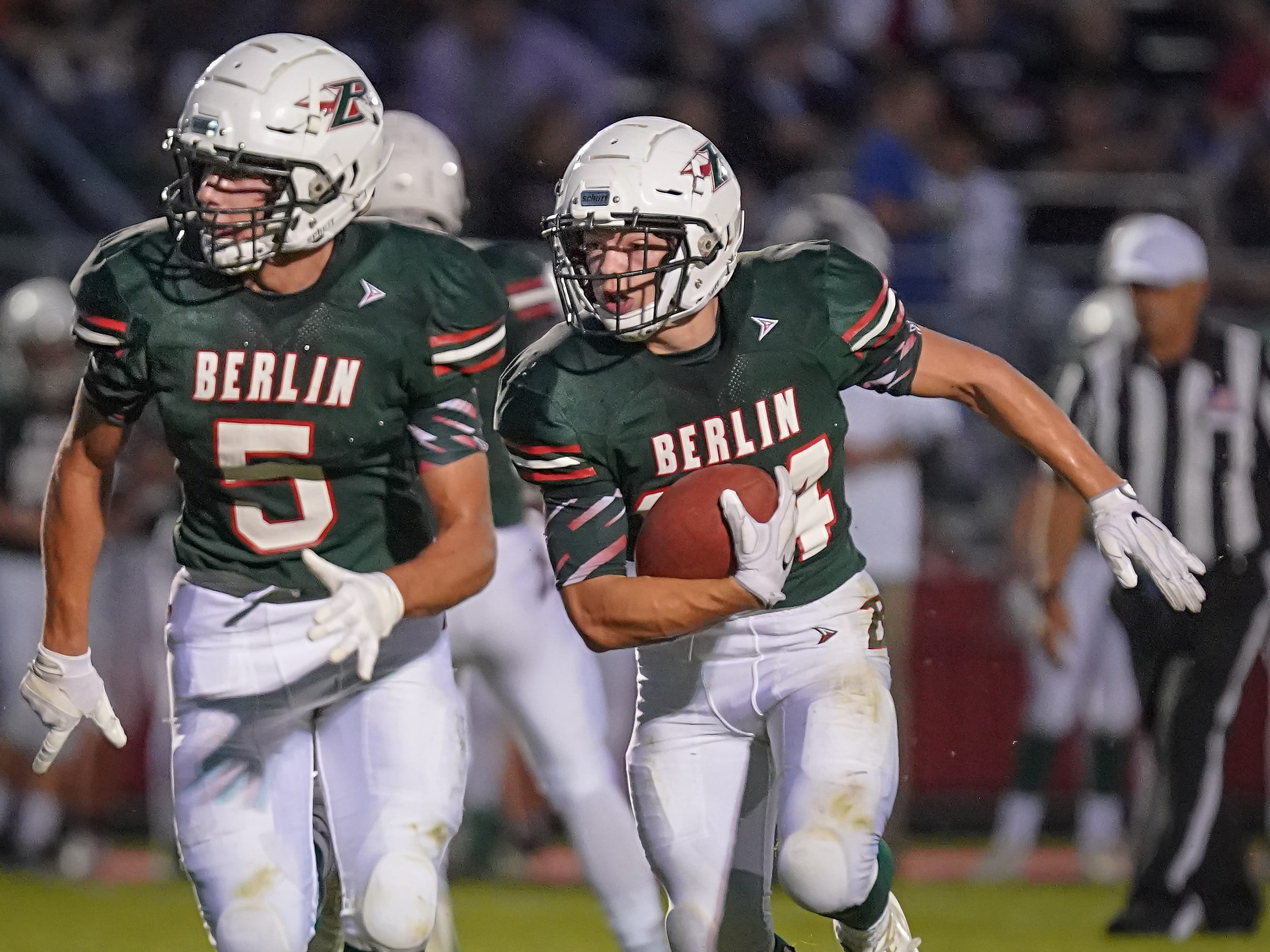 Alec Moriarty (5) of Berlin leads the blocking for Aidan Schilling (24). The Berlin Indians hosted the Winneconne Wolves in an East Central Conference matchup Friday evening, September 14, 2018.