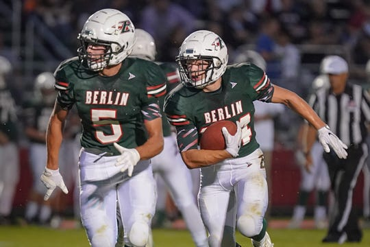 Berlin running back Alec Moriarty (5) leads the blocking for Aidan Schilling (24) during Friday night's game against Winneconne.