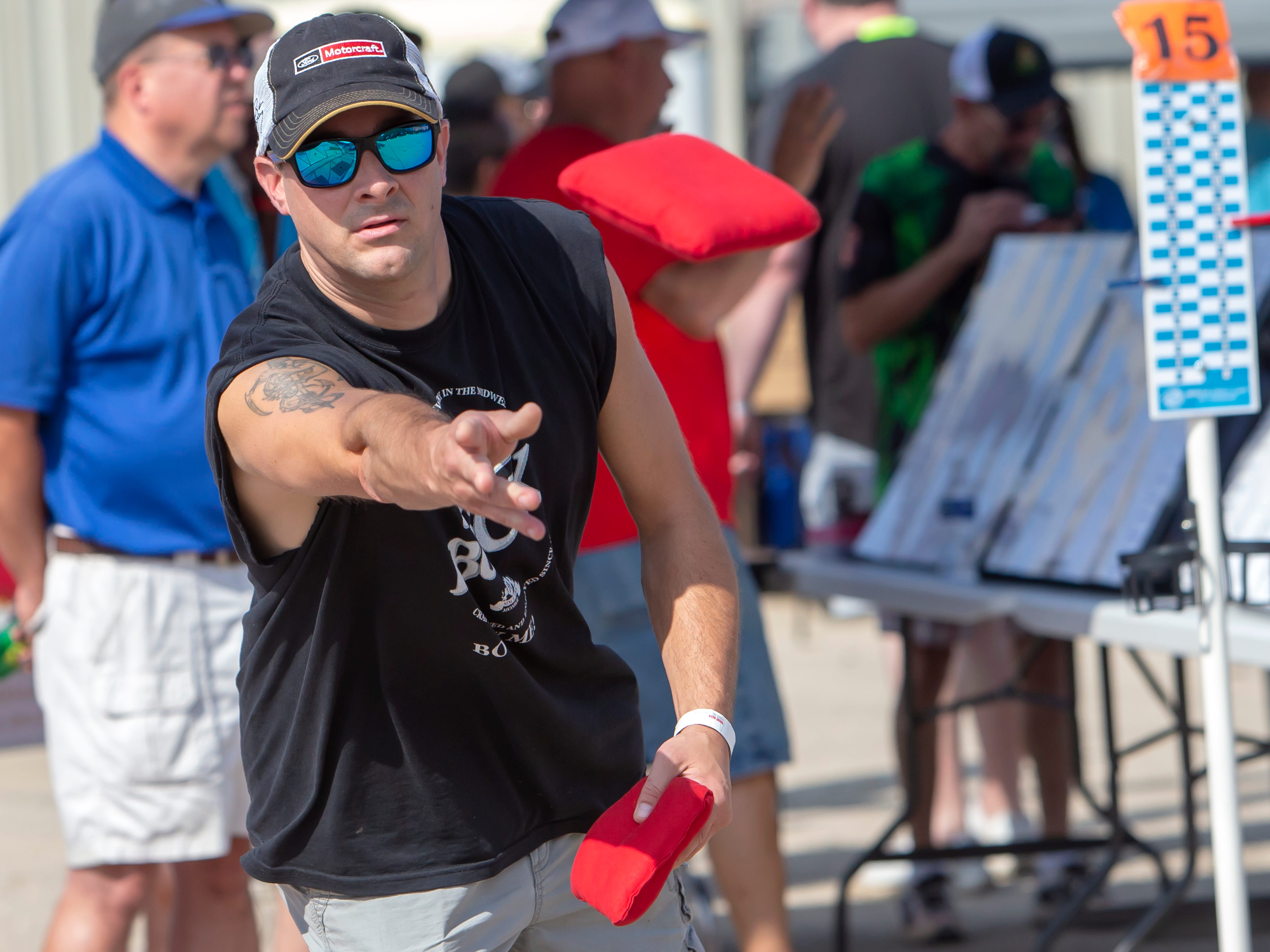 Mike Huber tosses a bean bag competing in the Wisconsin Cornhole Tourney at Dockside Tavern in Oshkosh on Saturday, Sept. 15, 2018.