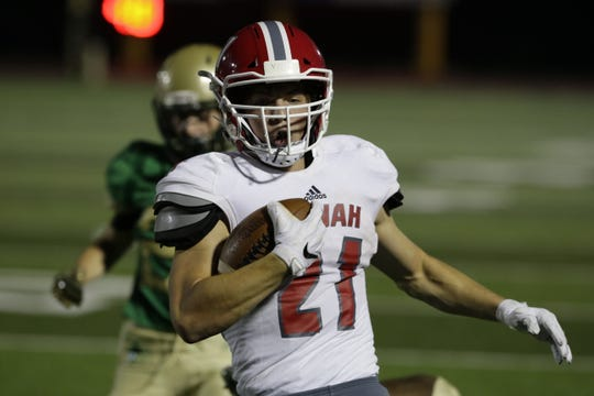Neenah's Carson Hughes runs the ball into the end zone during a Sept. 14 game against Oshkosh North. Hughes leads the team in rushing with 473 yards on 92 carries.