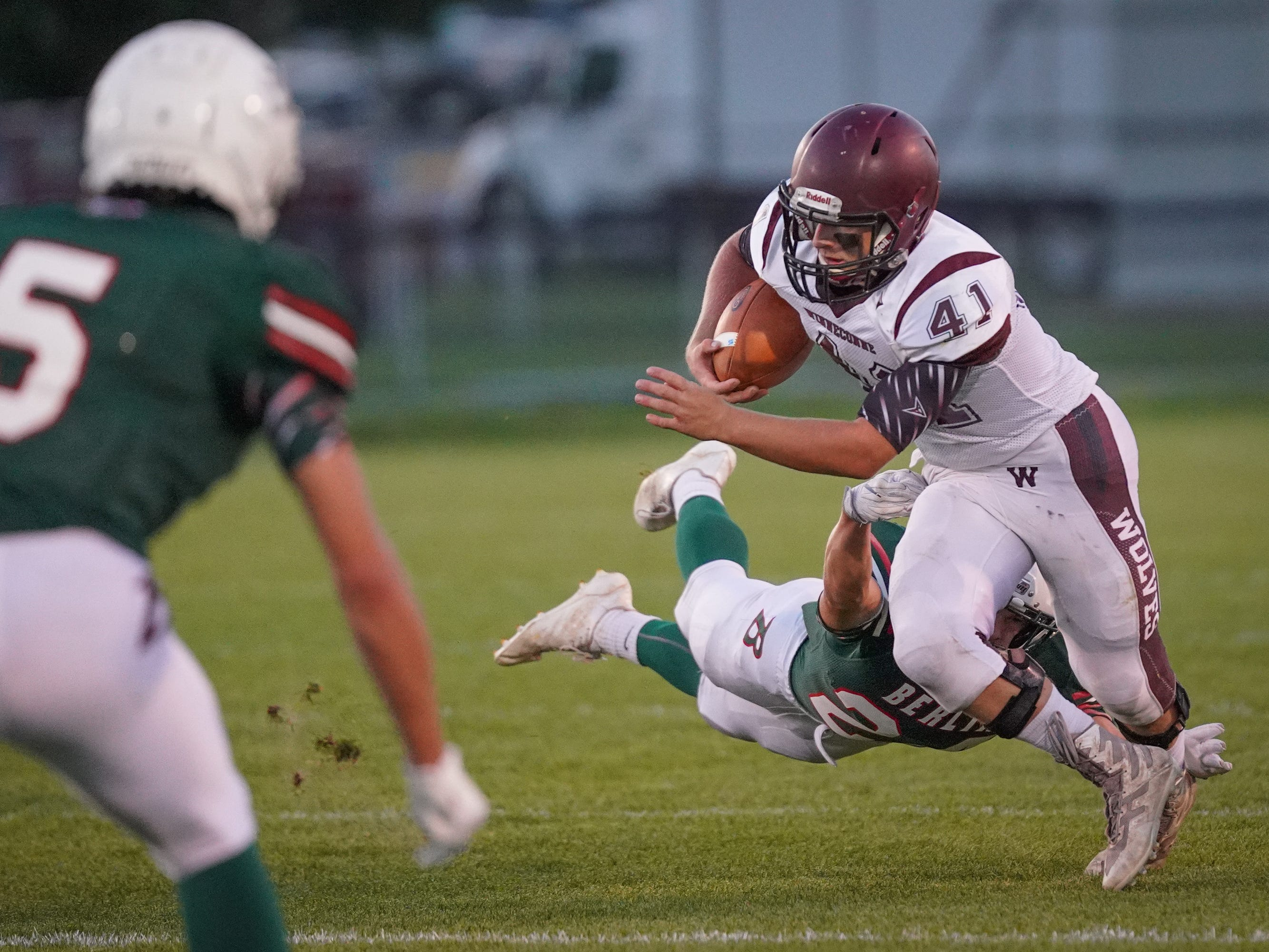 Wyatt Busching (41) of Winneconne gets tackled by Aidan Schilling (24) of Berlin. The Berlin Indians hosted the Winneconne Wolves in an East Central Conference matchup Friday evening, September 14, 2018.