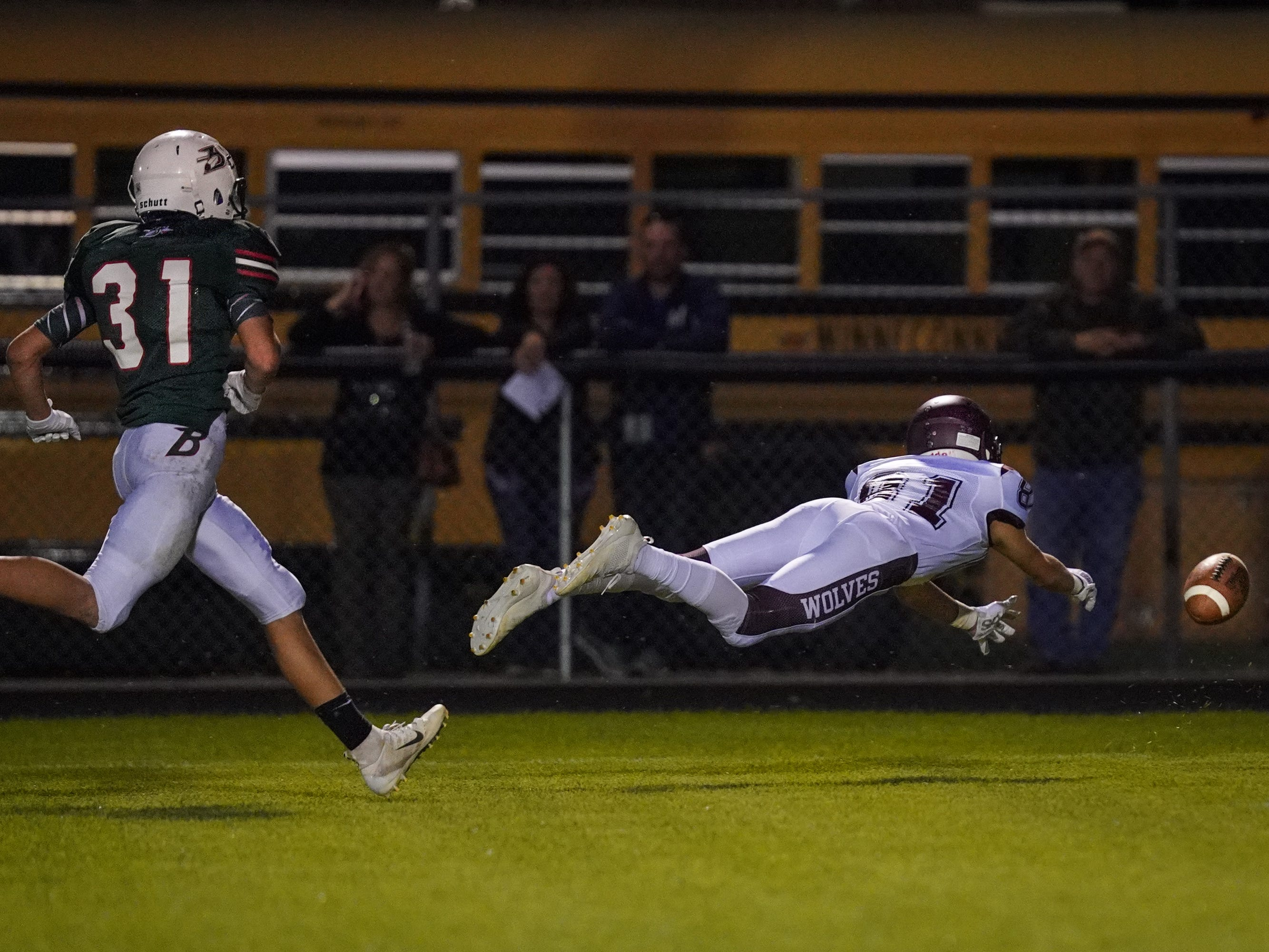 Michael Mathusek (81) of Winneconne dives for a pass. The Berlin Indians hosted the Winneconne Wolves in an East Central Conference matchup Friday evening, September 14, 2018.