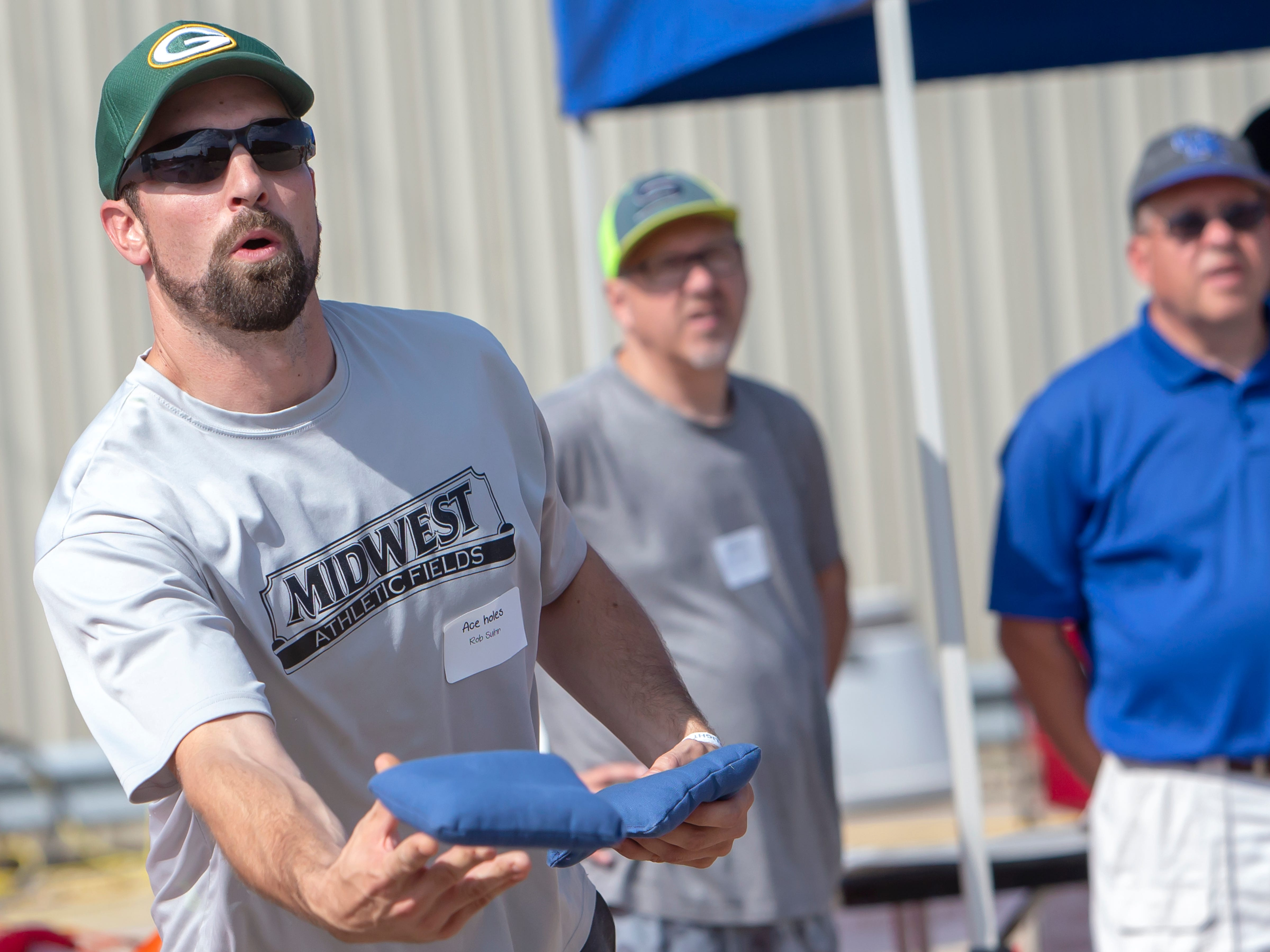 Rob Suhr tosses a blue bean bag competing in the Wisconsin Cornhole Tourney at Dockside Tavern in Oshkosh on Saturday, Sept. 15, 2018.