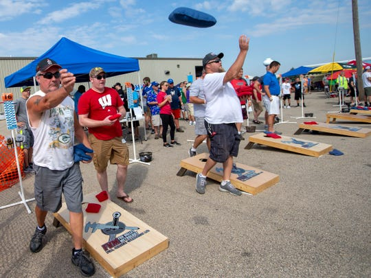 Defending champions Ed Reszynski, far left, and teammate Bryan Hughes from Watertown strive to repeat at the Wisconsin Cornhole Tourney at Dockside Tavern in Oshkosh on Saturday, Sept. 15, 2018.