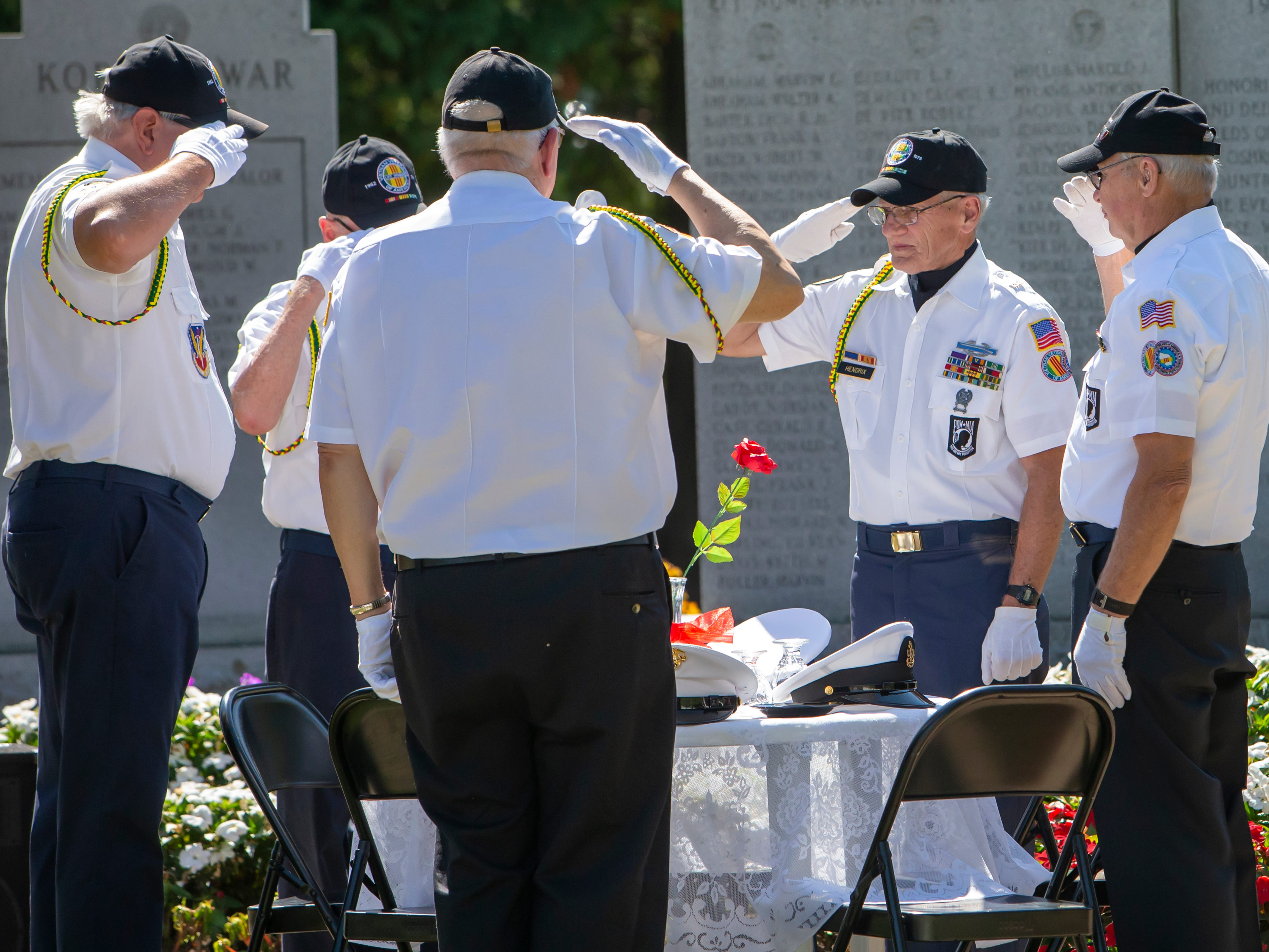 Each branch of the military is represented at the ceremonial table during the annual Annual POW MIA Remembrance Ceremony at South Park Veterans Memorial on Saturday, September 15, 2018.