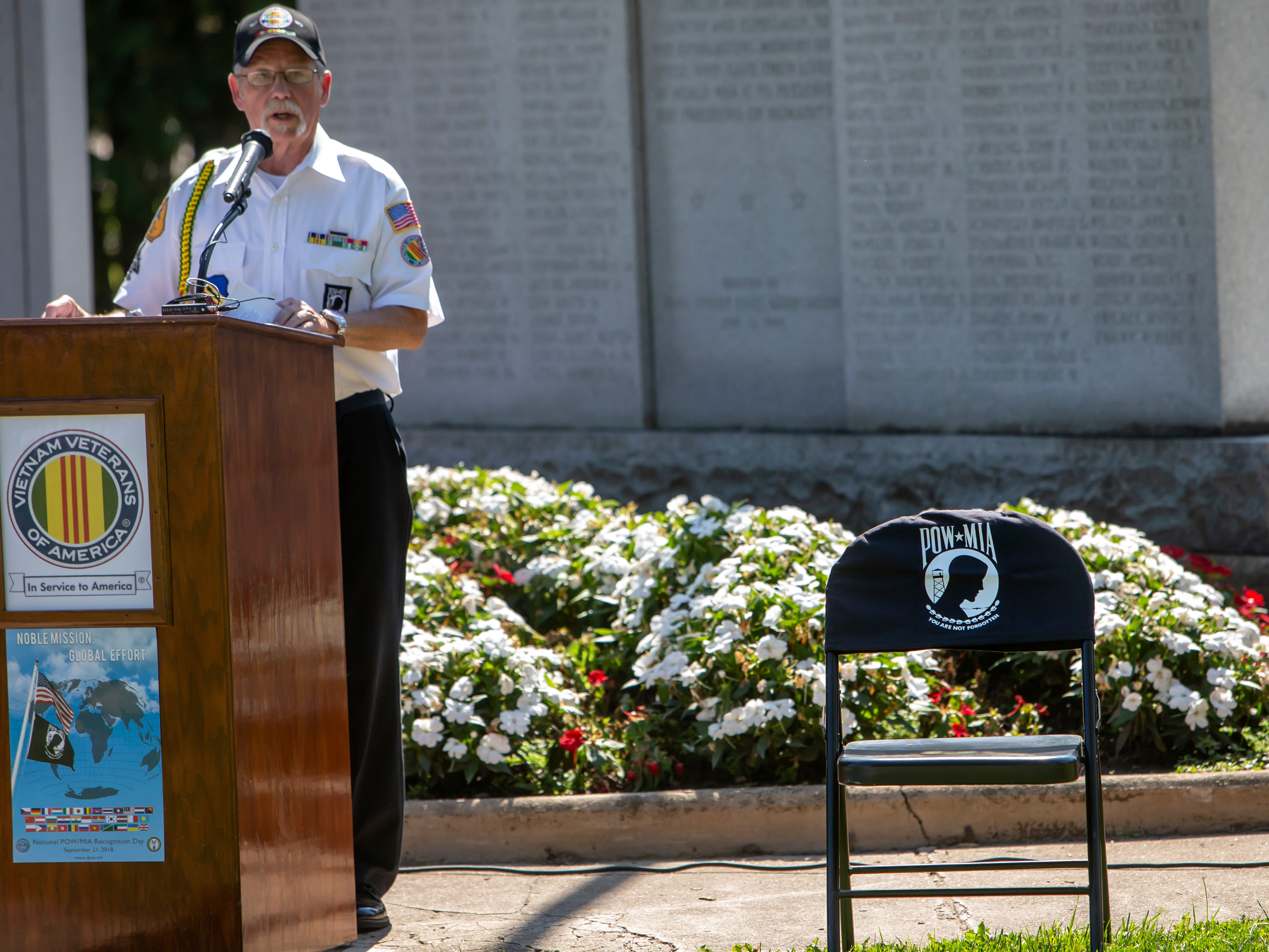 An empty chair stands a symbol to never forget those who have not returned from war during the annual POW MIA Remembrance Ceremony at South Park Veterans Memorial on Saturday, September 15, 2018.