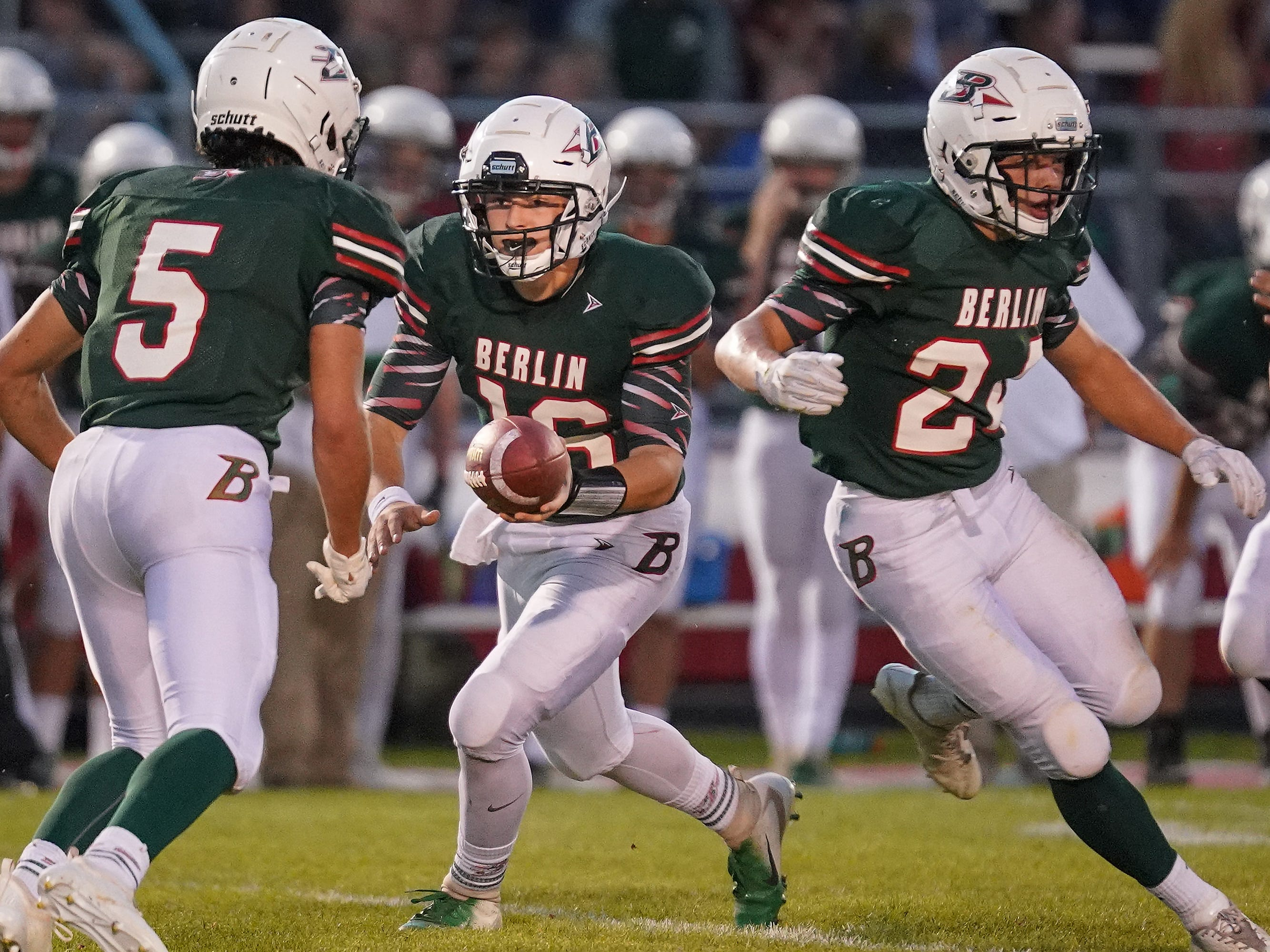 Berlin quartertback Lane Sobieski (16) hands off to Alec Moriarty (5) of Berlin. The Berlin Indians hosted the Winneconne Wolves in an East Central Conference matchup Friday evening, September 14, 2018.