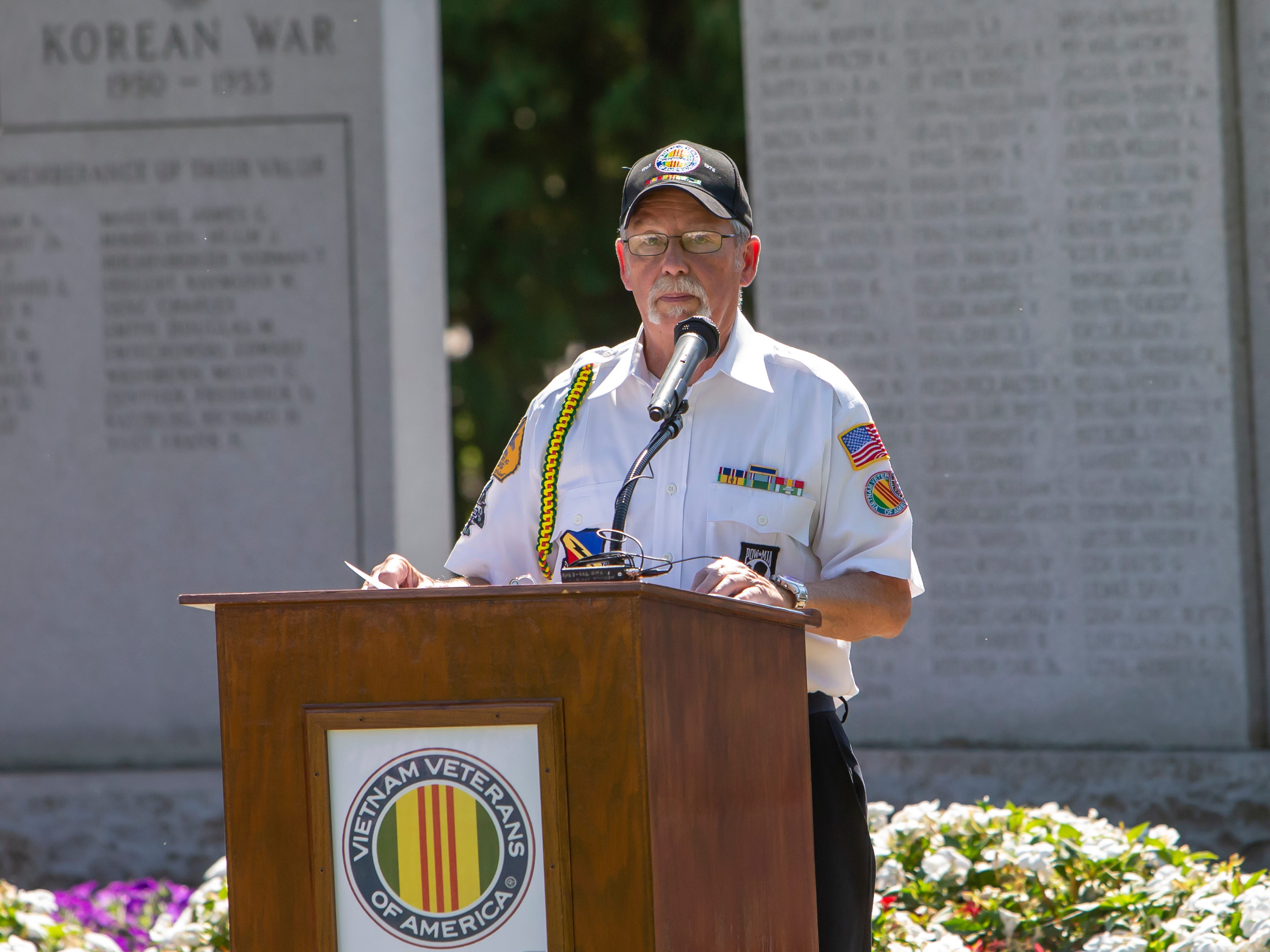 Duane Canon, President VVA Chapter 437, provides new and updated MIA numbers on the return of remains during the annual POW MIA Remembrance Ceremony at South Park Veterans Memorial on Saturday, September 15, 2018.