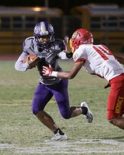 Shadow Hills' Trey Webb looks to avoid a Hemet defender in the first half on Friday.