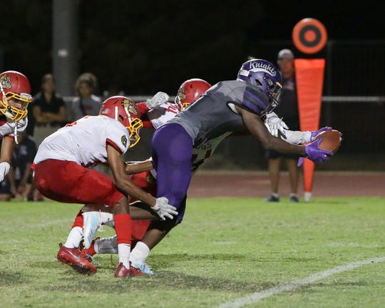 Shadow Hills' Kevin Johnson reaches forward for extra yardage against Hemet on Friday, Sept. 14, 2018.
