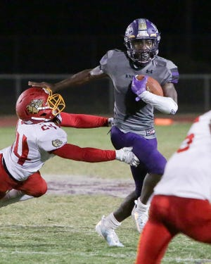Shadow Hills star Kevin Johnson stiff-arms a Hemet defender during the Knights' victory Friday night.