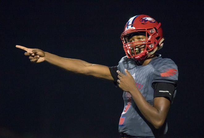 Ladarius Clardy (2) communicates with his coaches on the sideline during the Gulf Breeze vs Pine Forest football game at Pine Forest High School in Pensacola on Friday, September 14, 2018.