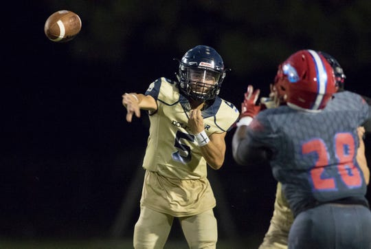 Quarterback Dylon Kelley (5) passes during the Gulf Breeze vs Pine Forest football game at Pine Forest High School in Pensacola on Friday, September 14, 2018.