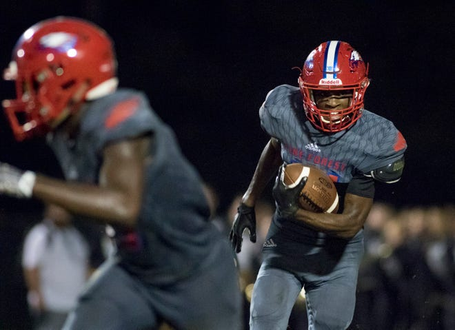 Devon Witherspoon (21) carries the ball during the Gulf Breeze vs Pine Forest football game at Pine Forest High School in Pensacola on Friday, September 14, 2018.