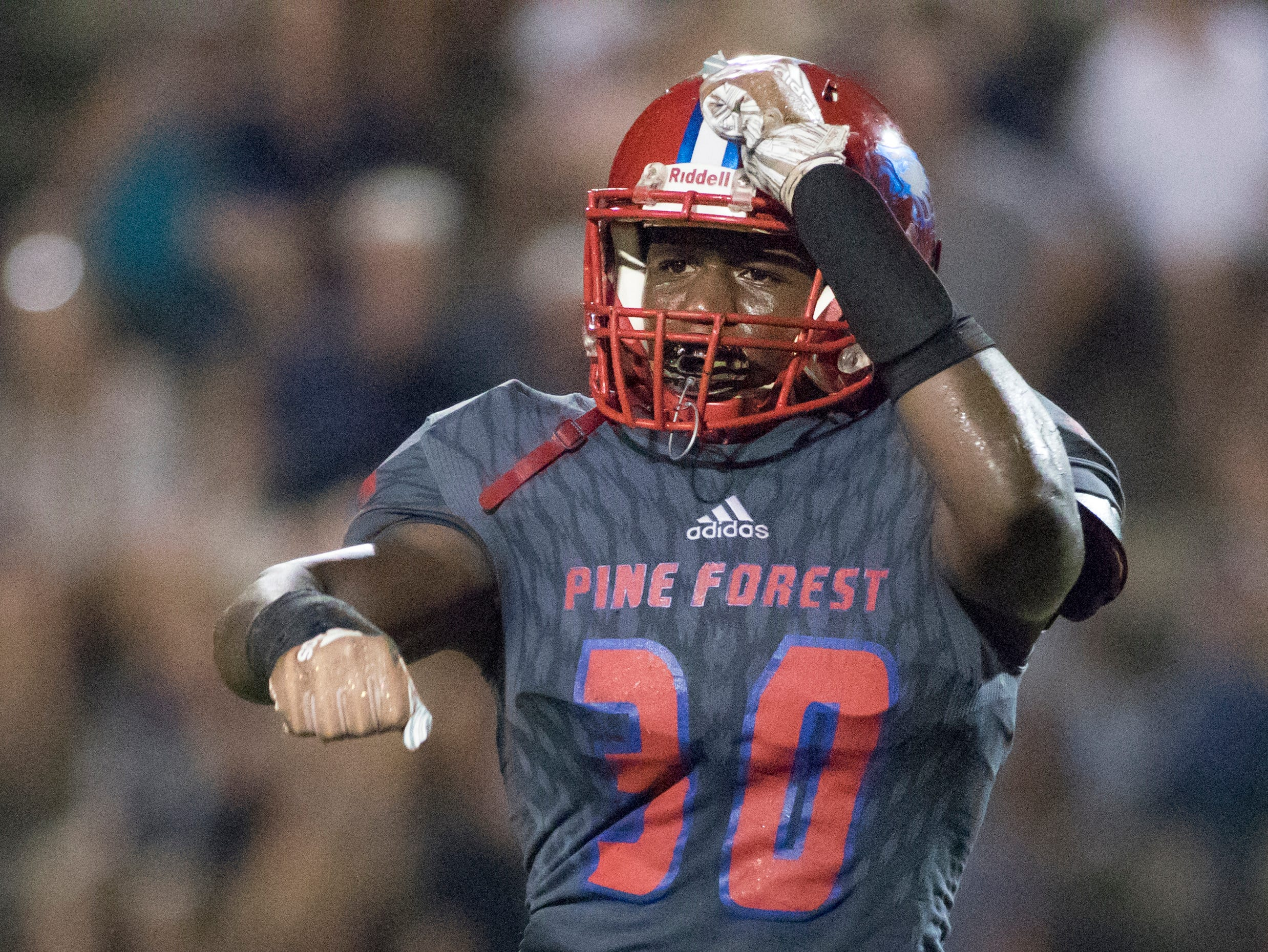 Taajhir Mccall (30) celebrates after sacking the quarterback during the Gulf Breeze vs Pine Forest football game at Pine Forest High School in Pensacola on Friday, September 14, 2018.