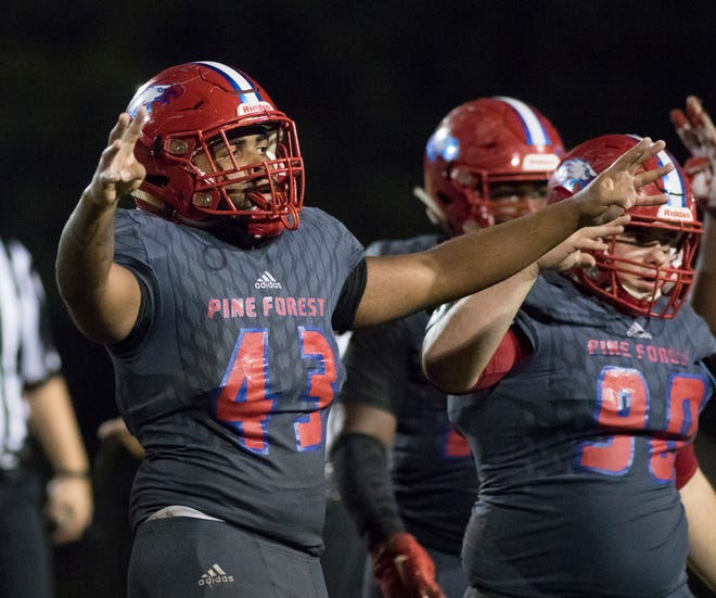 Linebacker Angel Craft (43) and teammates get set for the fourth quarter during the Gulf Breeze vs Pine Forest football game at Pine Forest High School in Pensacola on Friday, September 14, 2018.