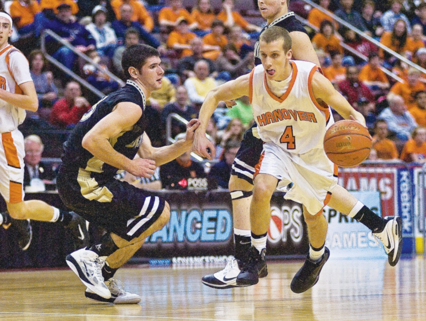 In this file photo from 2011, Delone Catholic's Mark Staub attempts to defend against a drive down court by Hanover's Pete Yingst during Friday's District 3 championship game in Hershey.  Hanover took the title 54 to 51.