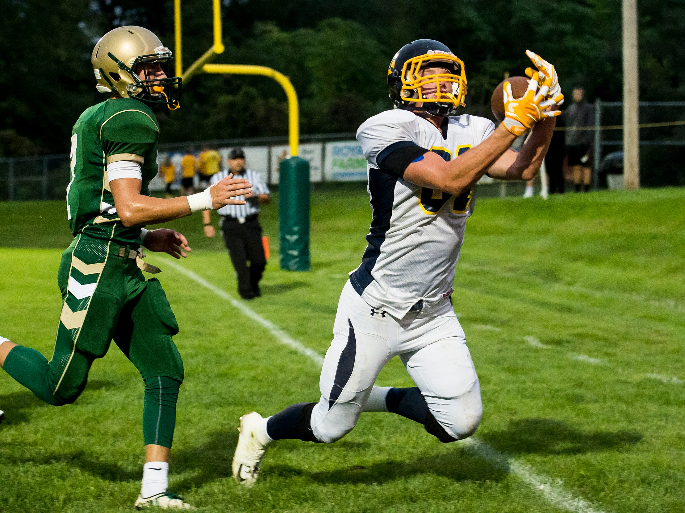 Littlestown's Brady McClintock hauls in a catch in the end zone during play against York Catholic on Friday, September 14, 2018. The catch was called incomplete as McClintock came down out of bounds.
