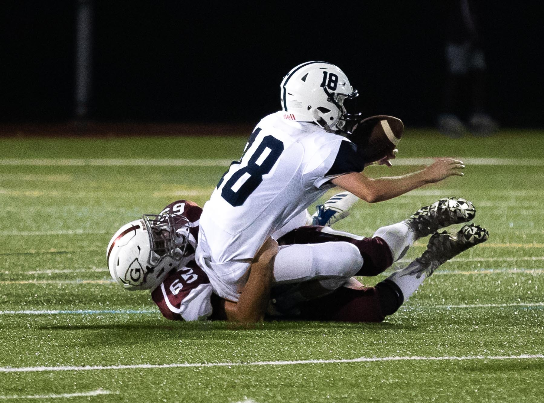 West York's Corey Wise (18) is brought down by Gettysburg's Jacob Schaub (65) during a football game between Gettysburg and West York, Friday, Sept. 14, 2018, in Gettysburg. Gettysburg defeated West York 42-22.