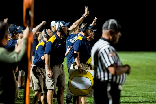 Littlestown coaches hold up four fingers to signal fourth down after the referees decided it was third down following a penalty during Friday's game against York Catholic on September 14, 2018.
