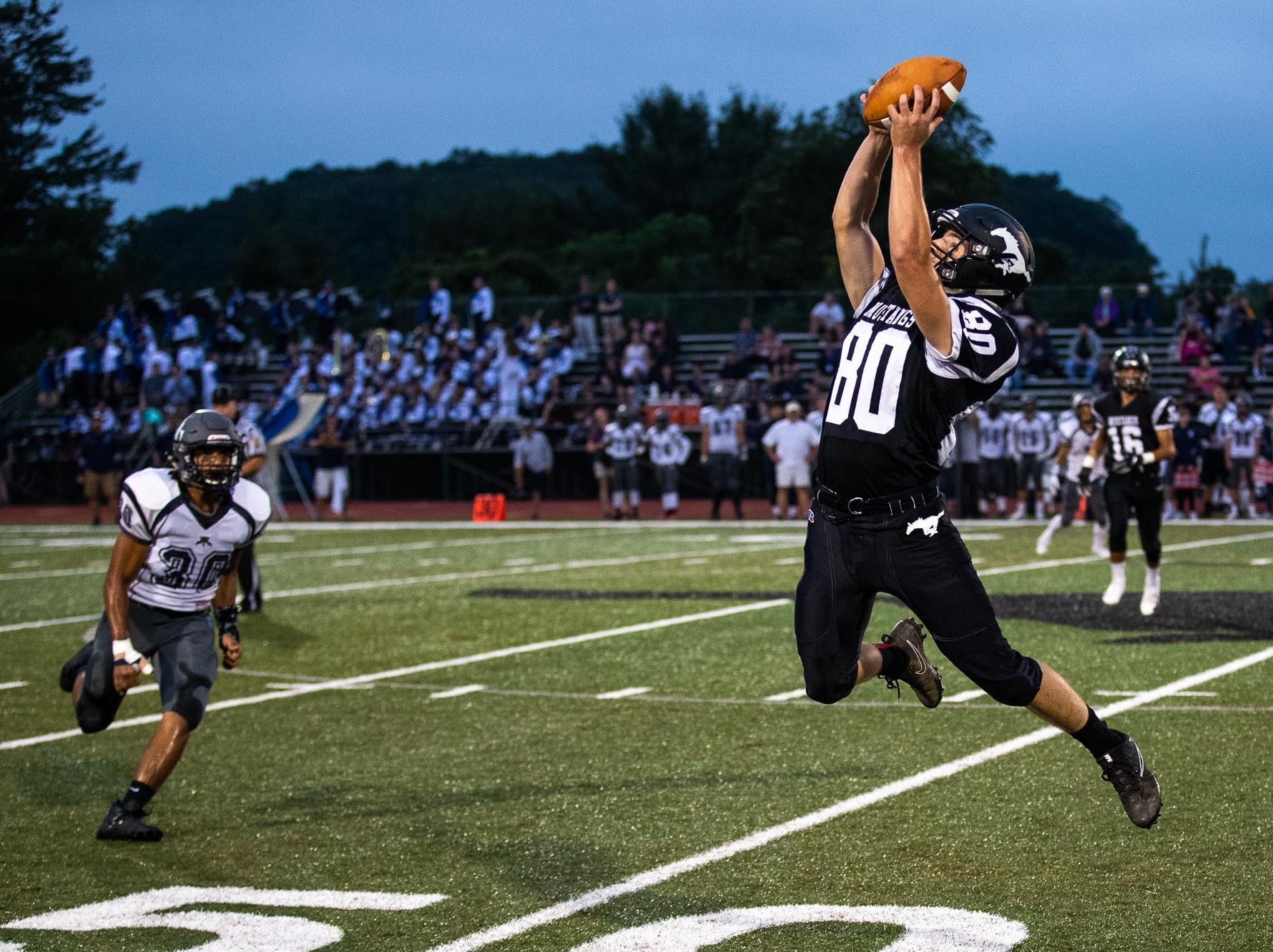 South Western's Garrett Wilson (80) flies into the air to catch a pass during a football game between South Western and Dallastown, Friday, Sept. 14, 2018, at South Western High School in Penn Township. Dallastown won, 35-7.