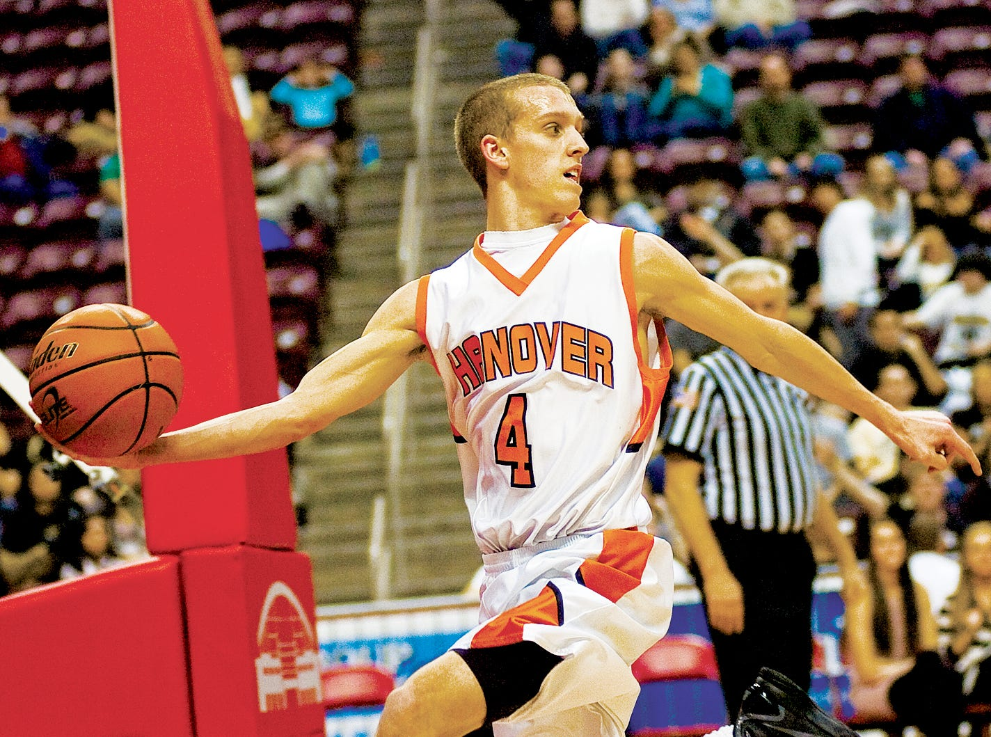 In this file photo from 2011, Hanover's Pete Yingst jumps on a rebound during Friday's championship District 3 game against Delone Catholic. Hanover took the title 54 to 51 at the Giant Center in Hershey.