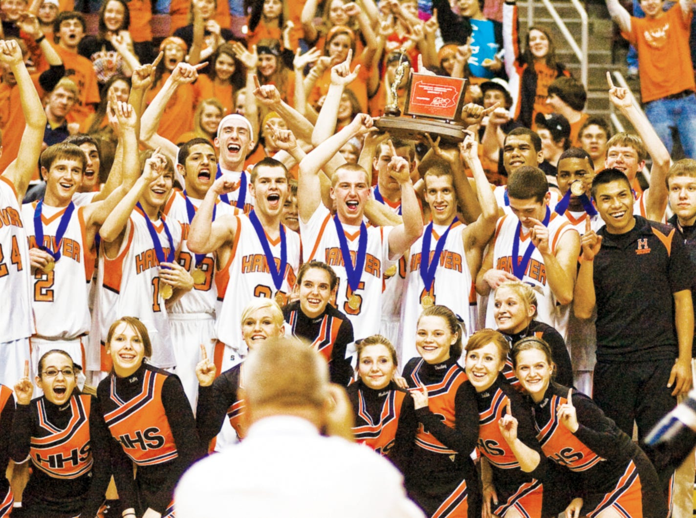 In this file photo from 2011, Hanover celebrates their win during a team photo shoot after besting Delone Catholic 54 to 51 during Friday night's championship game in Hershey.
