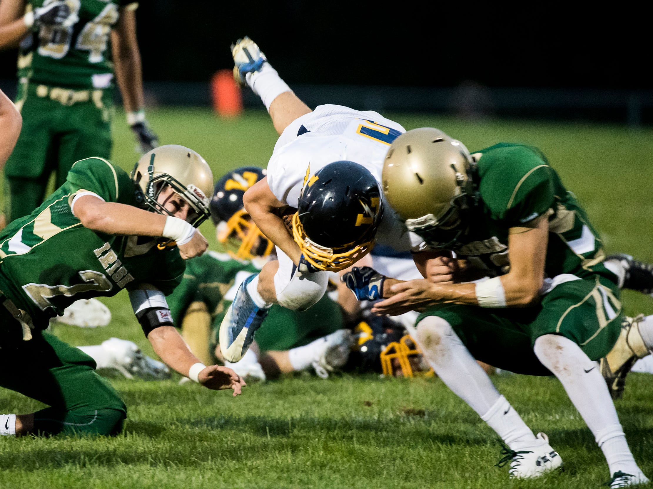Littlestown's Corbin Brown goes airborne while running the ball up the middle against York Catholic on Friday, September 14, 2018. The Bolts fell 22-19.