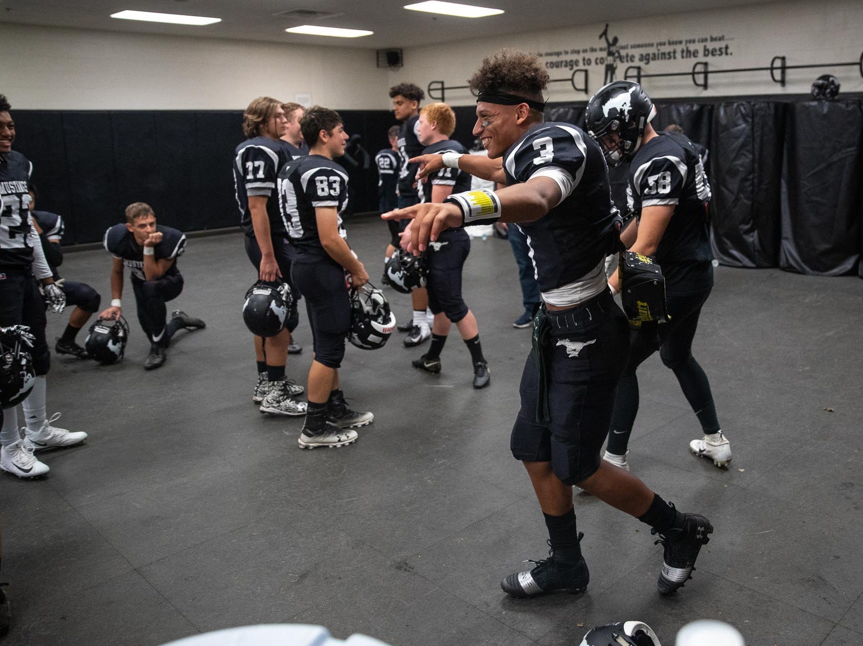 South Western's Jalen Bradford dances in the locker room before a football game between South Western and Dallastown, Friday, Sept. 14, 2018, at South Western High School in Penn Township. Dallastown won, 35-7.