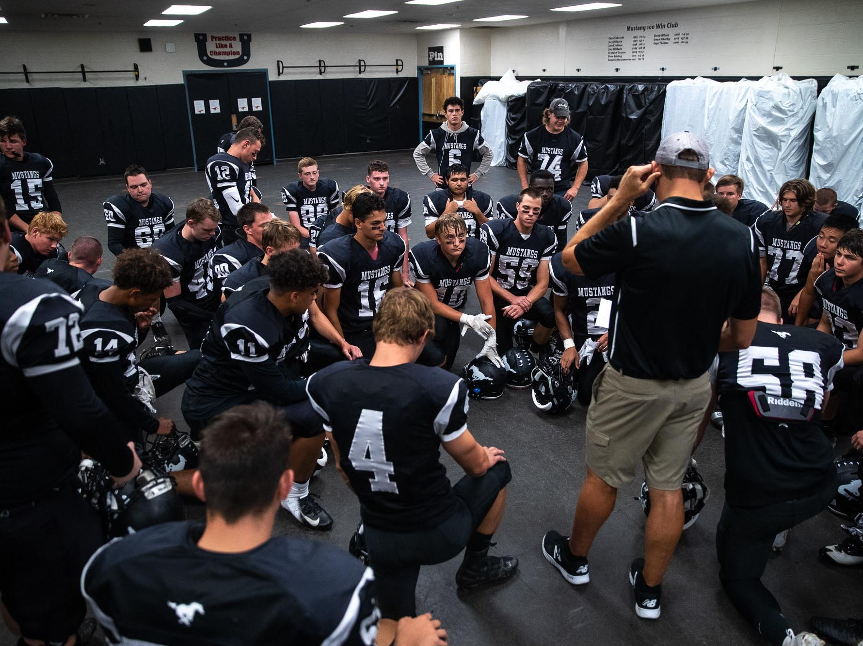 South Western players listen to headcoach Chris Heilman in the locker room before a football game between South Western and Dallastown, Friday, Sept. 14, 2018, at South Western High School in Penn Township. Dallastown won, 35-7.