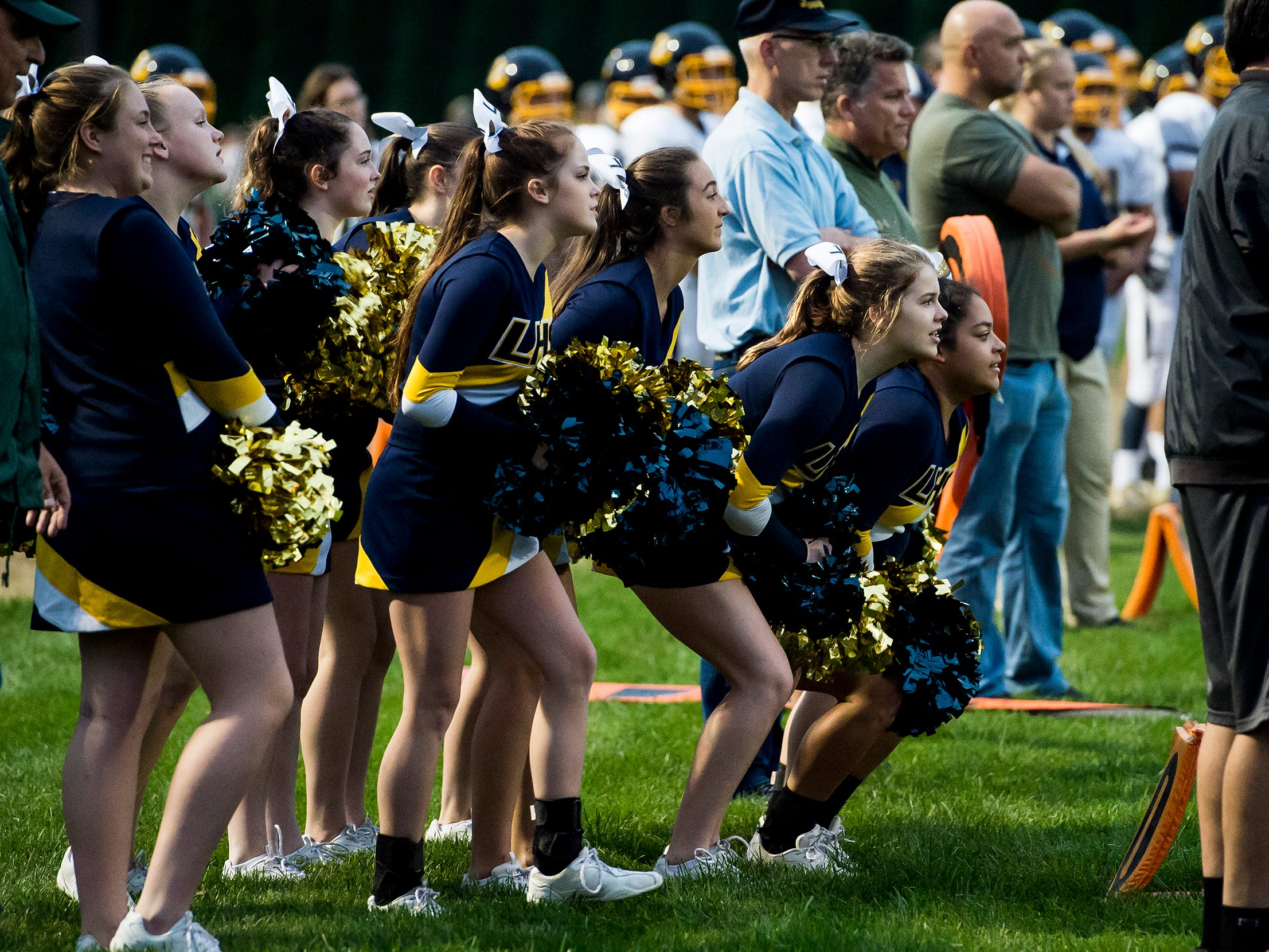 Littlestown cheerleaders look on during a key play in a game against York Catholic on Friday, September 14, 2018. The Bolts lost 22-19.