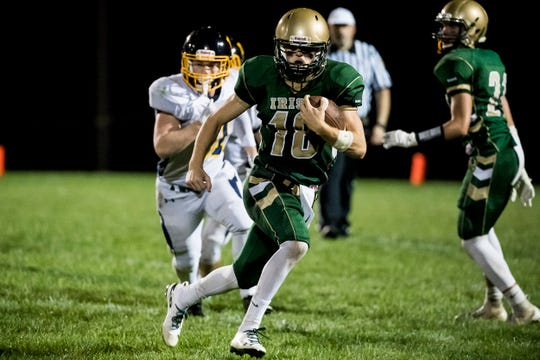 York Catholic's Wesley Burns runs with the ball against Littlestown on Friday, September 14, 2018. The Bolts fell to the Fighting Irish 22-19.