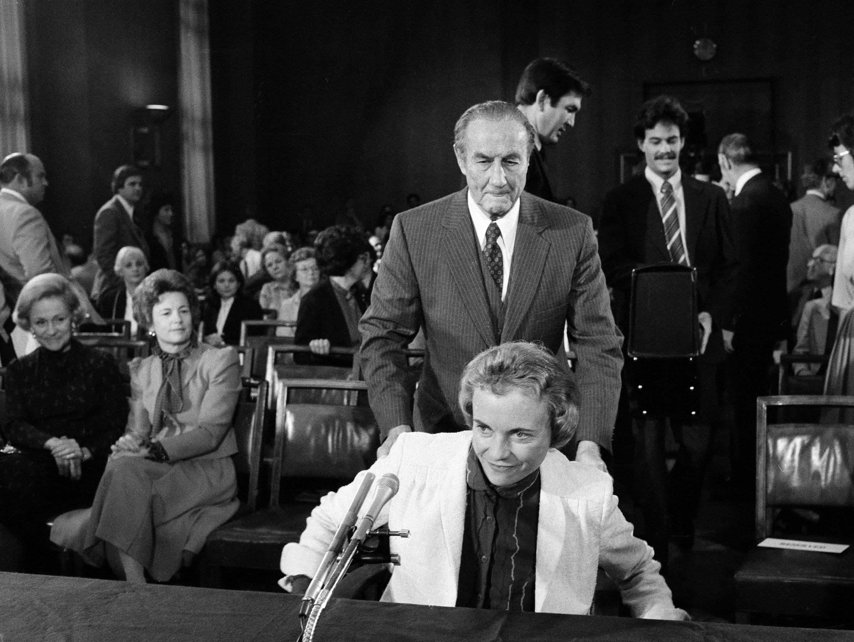 Chairman of the Senate Judiciary Committee Strom Thurmond, R-S.C., holds the chair for Supreme Court nominee Sandra Day O'Connor as she arrives for the start of her confirmation hearings before his panel, Sept. 10, 1981, on Capitol Hill.