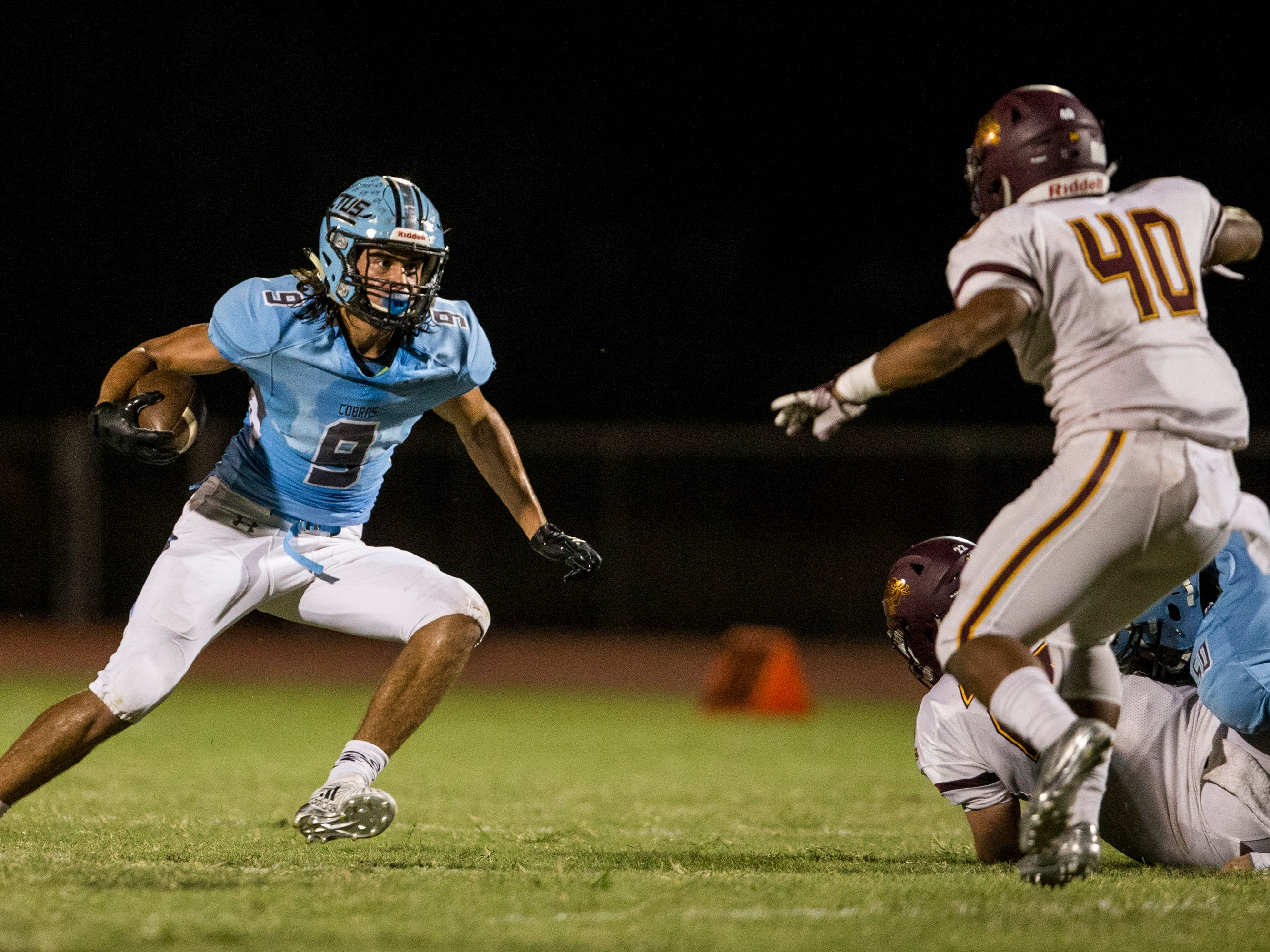 Cactus' Zaach Cullop rushes against Salpointe in the 1st quarter on Friday, Sept. 14, 2018, at Cactus High School in Glendale, Ariz.