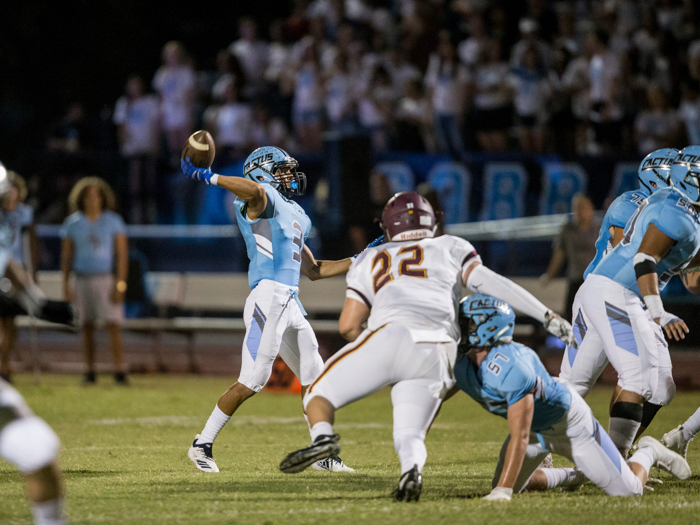 Cactus' Garrett Monroe throws for a touchdown against Salpointe in the 1st quarter on Friday, Sept. 14, 2018, at Cactus High School in Glendale, Ariz.