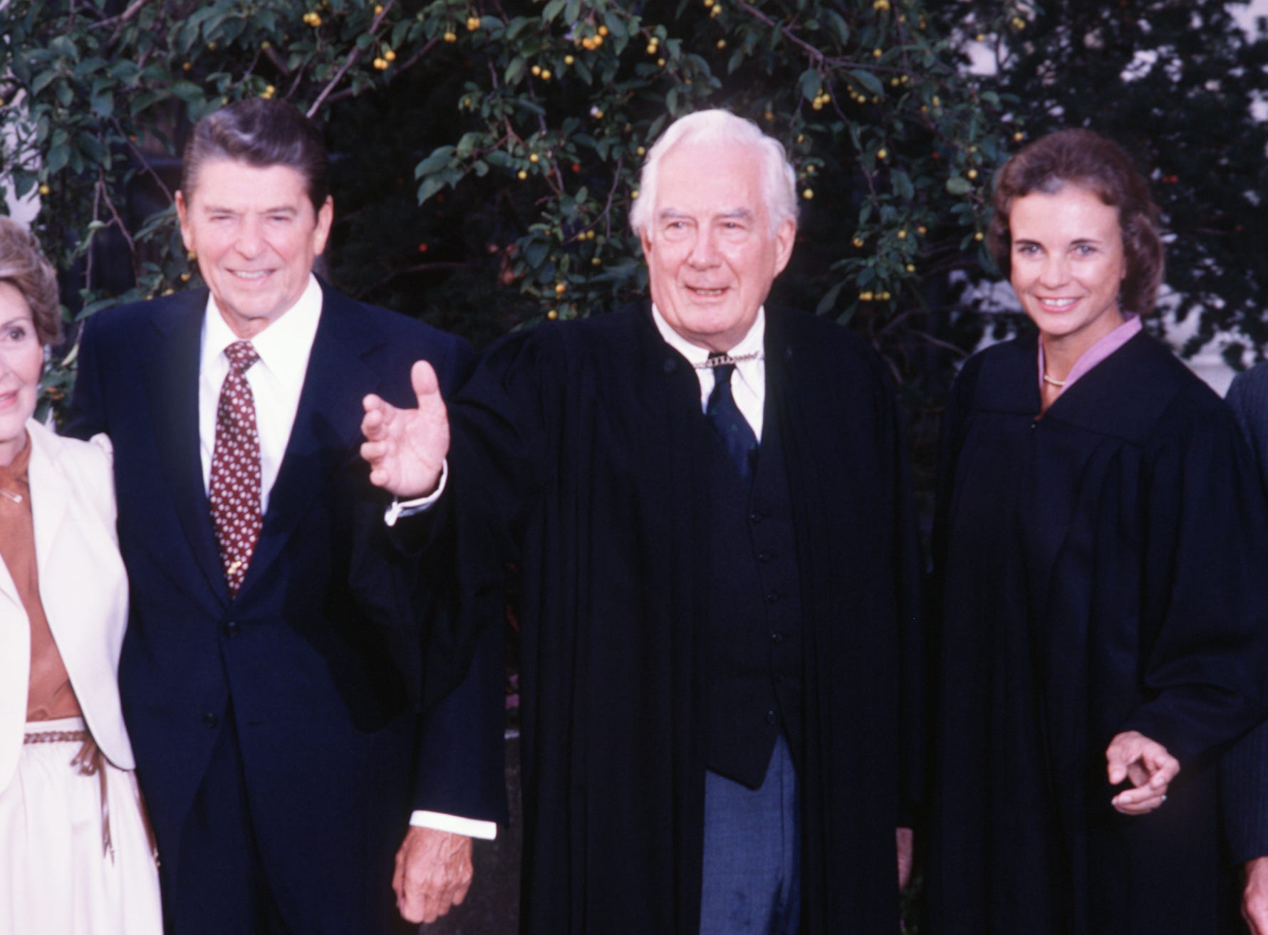 Sandra Day O'Connor, Associate Justice of the Supreme Court, second from right, poses with President Ronald Reagan and first lady Nancy Reagan, right, and Chief Justice Warren Burger following her swearing in at the Supreme Court in Washington, Sept. 25, 1981.  O'Connor's husband, John O'Connor, is seen at far right. O'Connor.