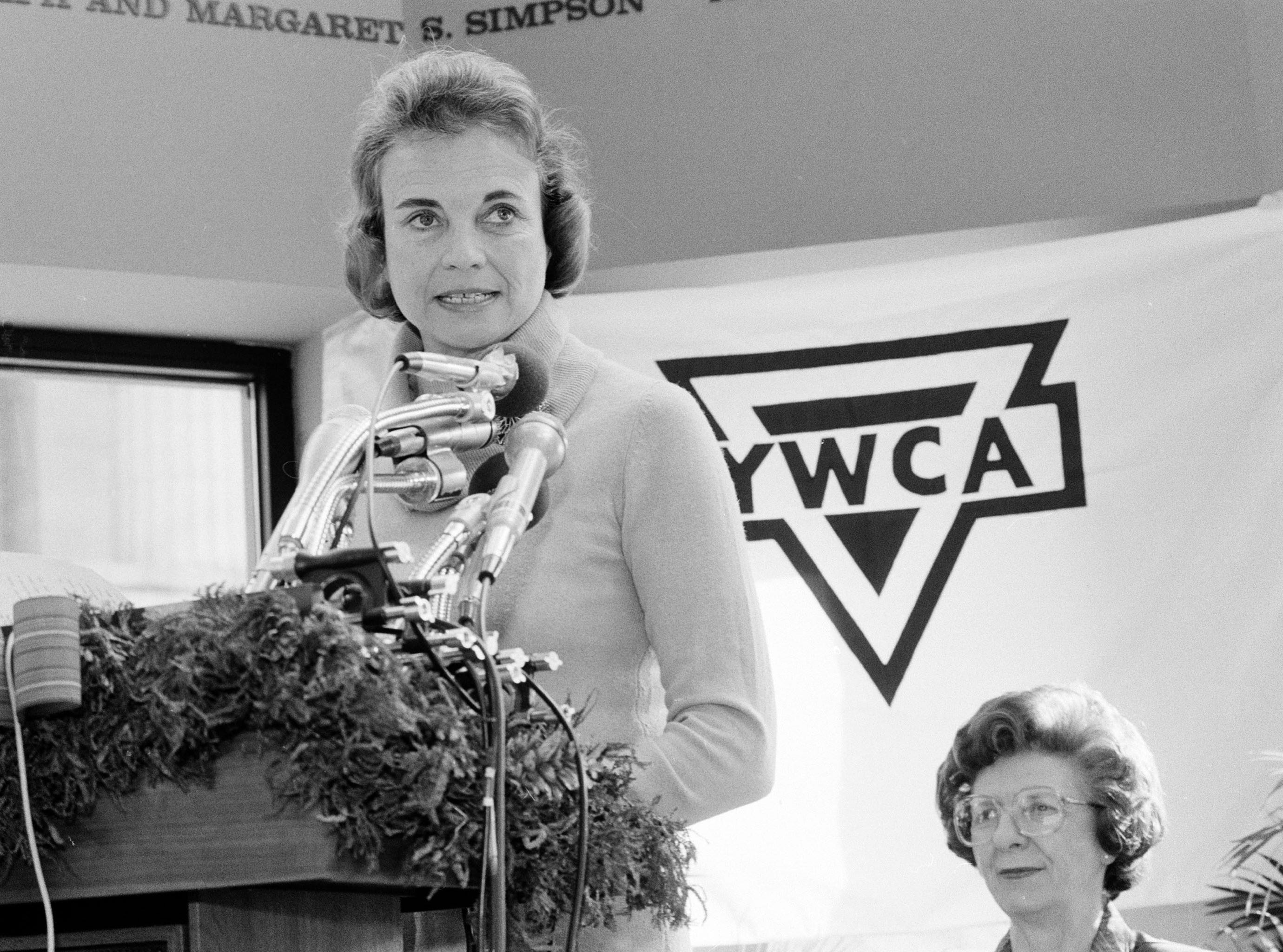 U.S. Supreme Court Justice Sandra Day O'Connor speaks during the dedication ceremonies for the opening of the new headquarters for the YWCA, Dec. 10, 1981, in Washington.  Woman at right is unidentified.