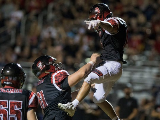 Liberty's Jake Morris gets thrown in the air by his lineman Frank Thompson after scoring a touchdown against Leland (CA) during their game Friday, Sept.14, 2018. Thompson recently went through a tough recruiting experience with ASU, his dream school.